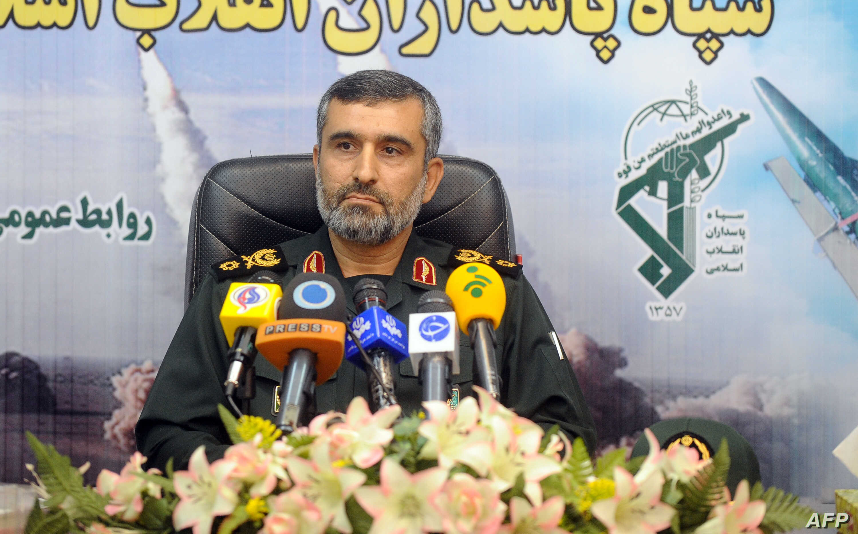 A picture obtained on Aug. 25, 2014 from Iran's ISNA news agency and taken on Jan.y 7, 2012 shows General Amirali Hajizadeh, commander of aerial forces of Iran's elite Revolutionary Guards giving a press conference in Tehran.