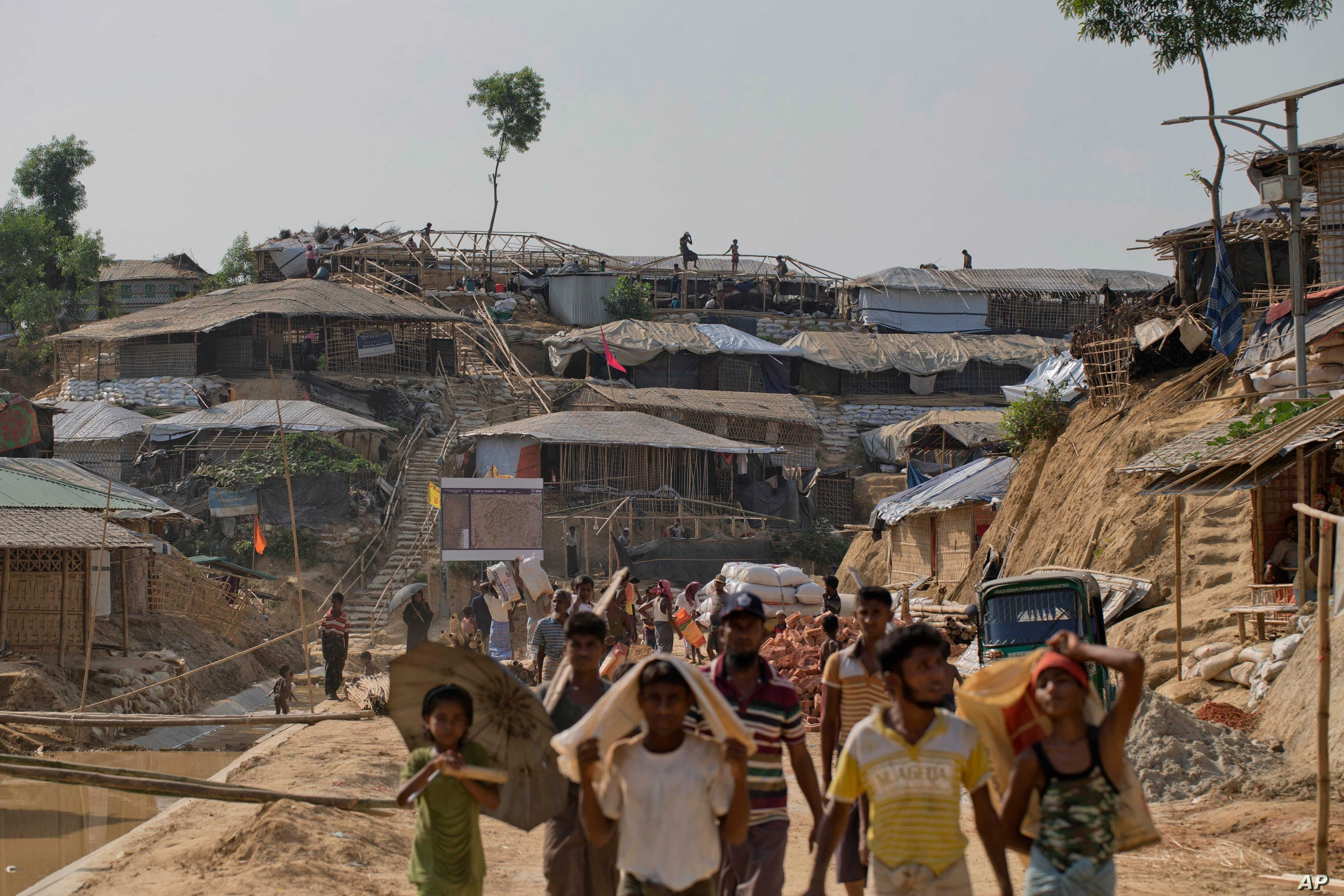 Rohingya refugees rebuild their makeshift houses, in preparation for the approaching monsoon season at the Kutupalong Rohingya refugee camp in Kutupalong, Bangladesh, April 28, 2018. Rohingya refugees who fled Myanmar during a brutal crackdown now fa