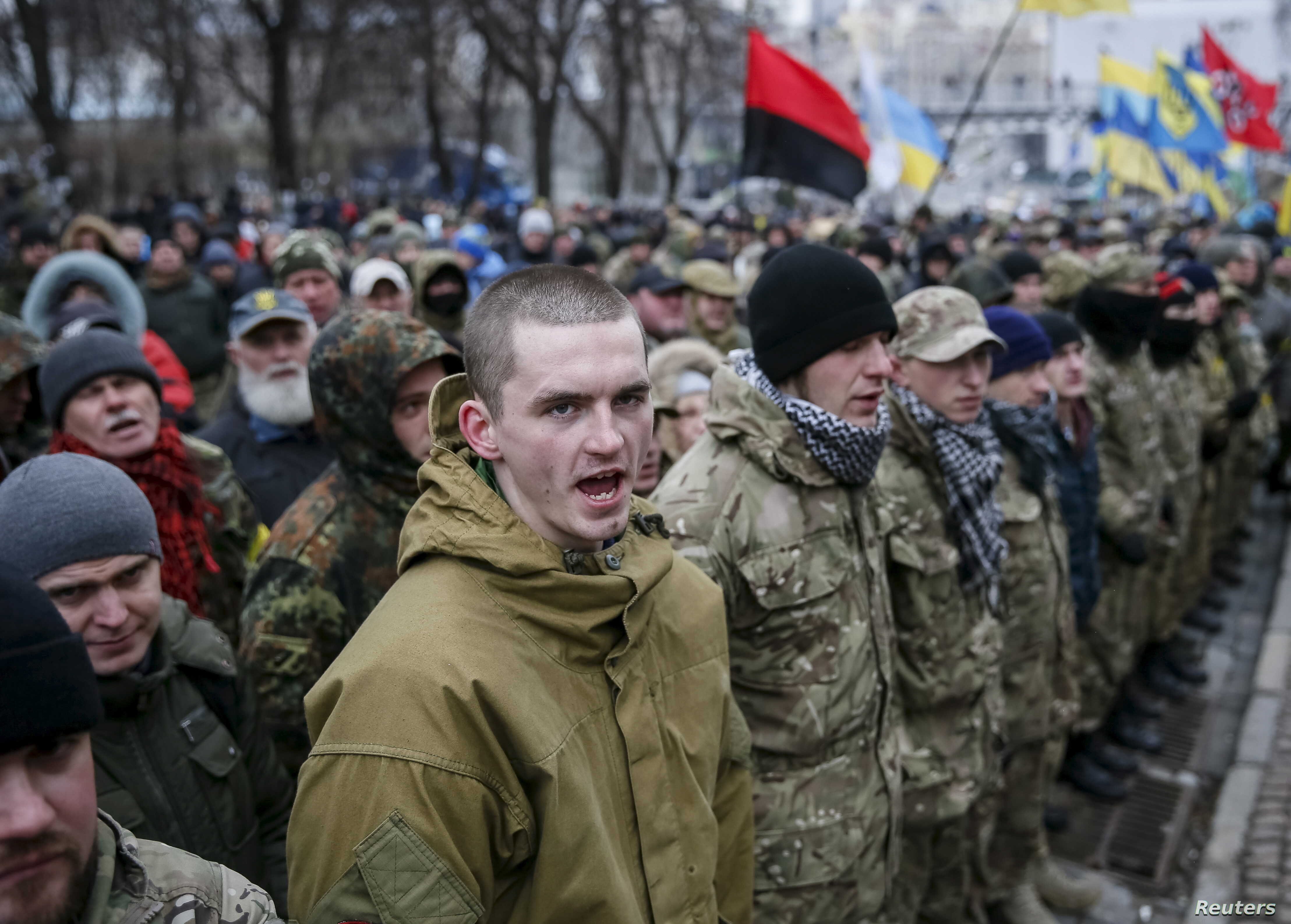 Members of self-defense battalions take part in a rally to commemorate demonstrators who were killed during the Maidan protests in 2014 in Kiev, Ukraine, Feb. 20, 2016.