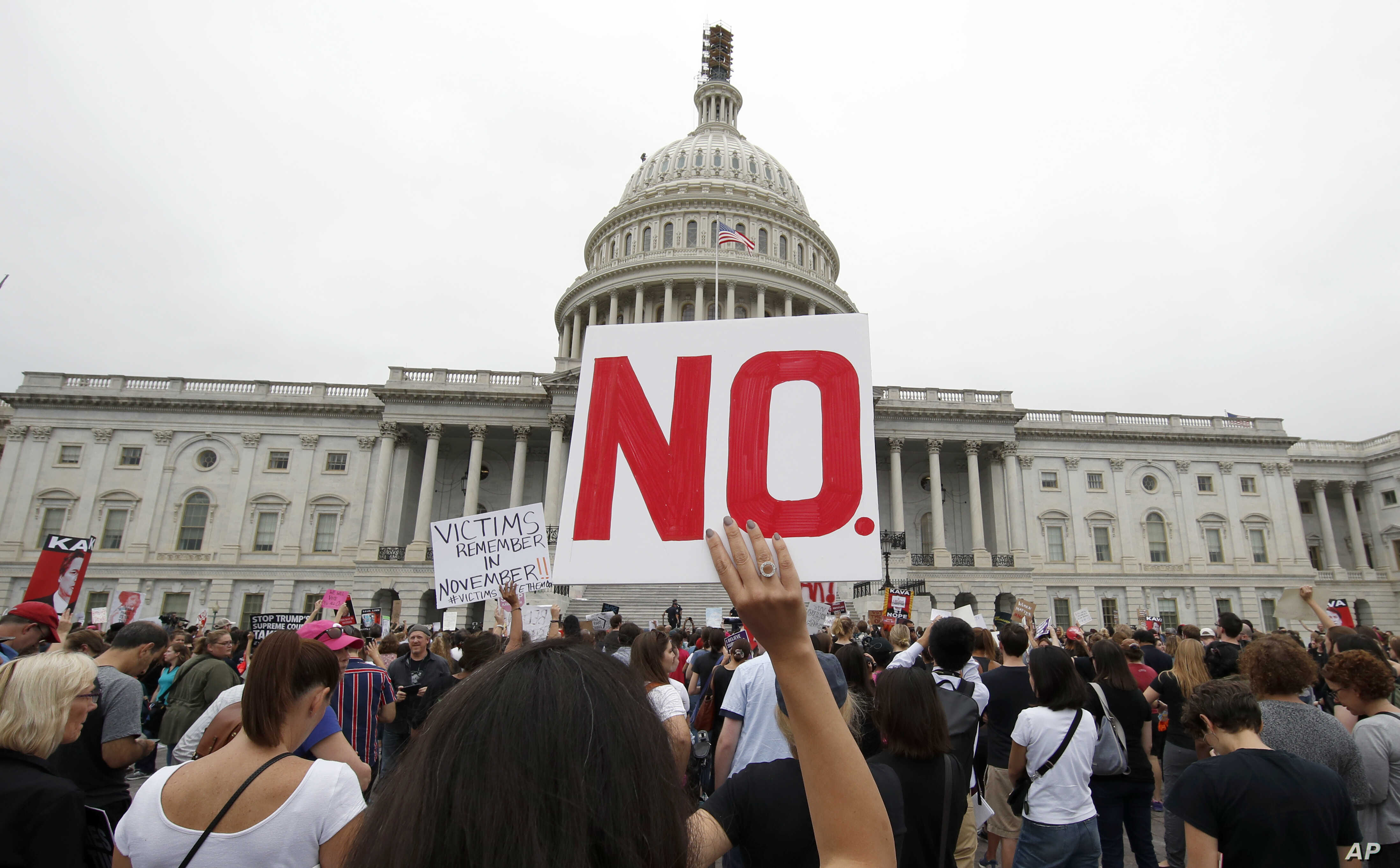 Activists demonstrate in the plaza of the East Front of the U.S. Capitol to protest the confirmation vote of Supreme Court nominee Brett Kavanaugh on Capitol Hill, Oct. 6, 2018, in Washington.