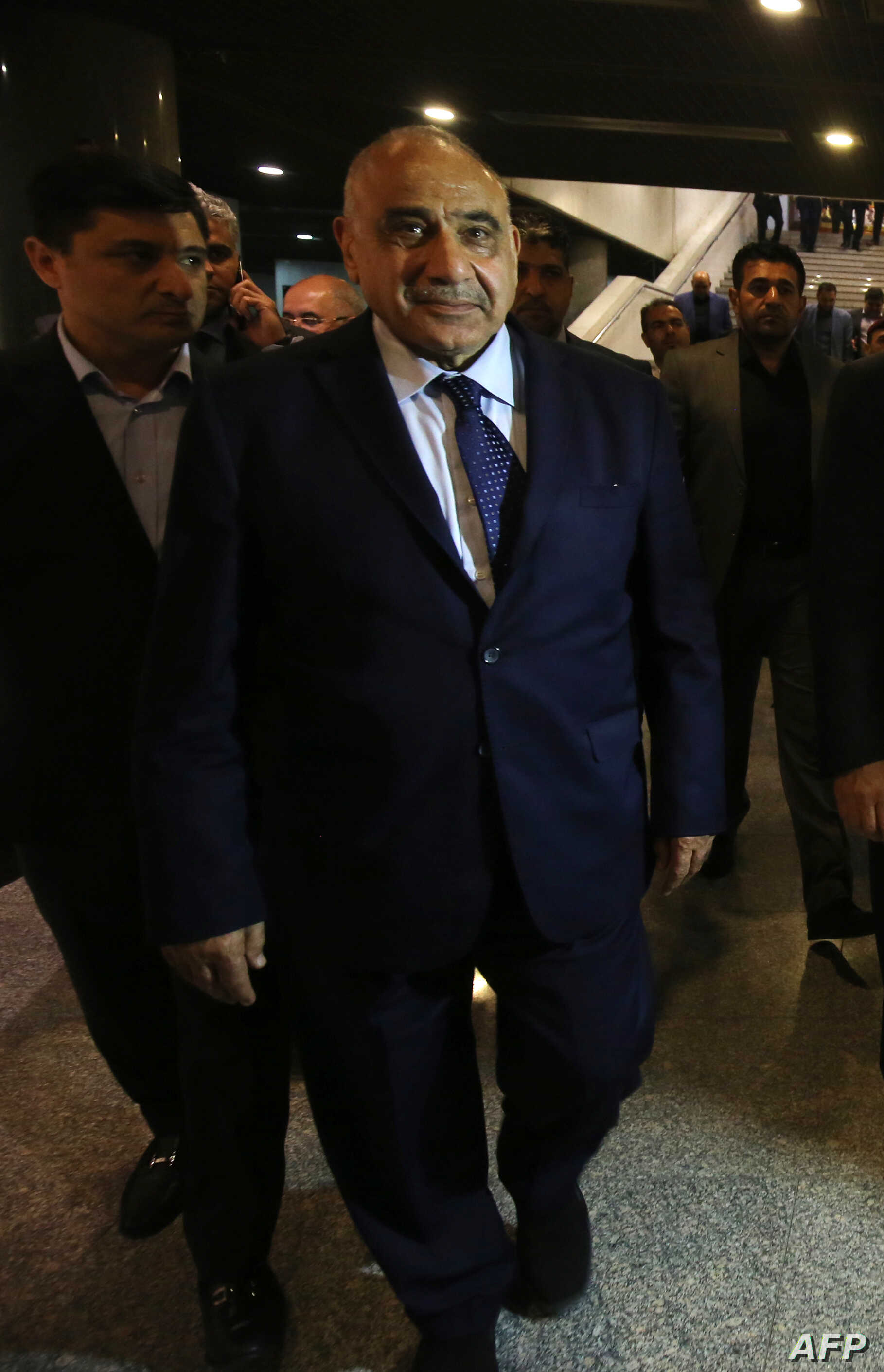 Iraqi Prime Minister Adel Abdul Mahdi walks out of the Parliament in Baghdad on Oct. 2, 2018.