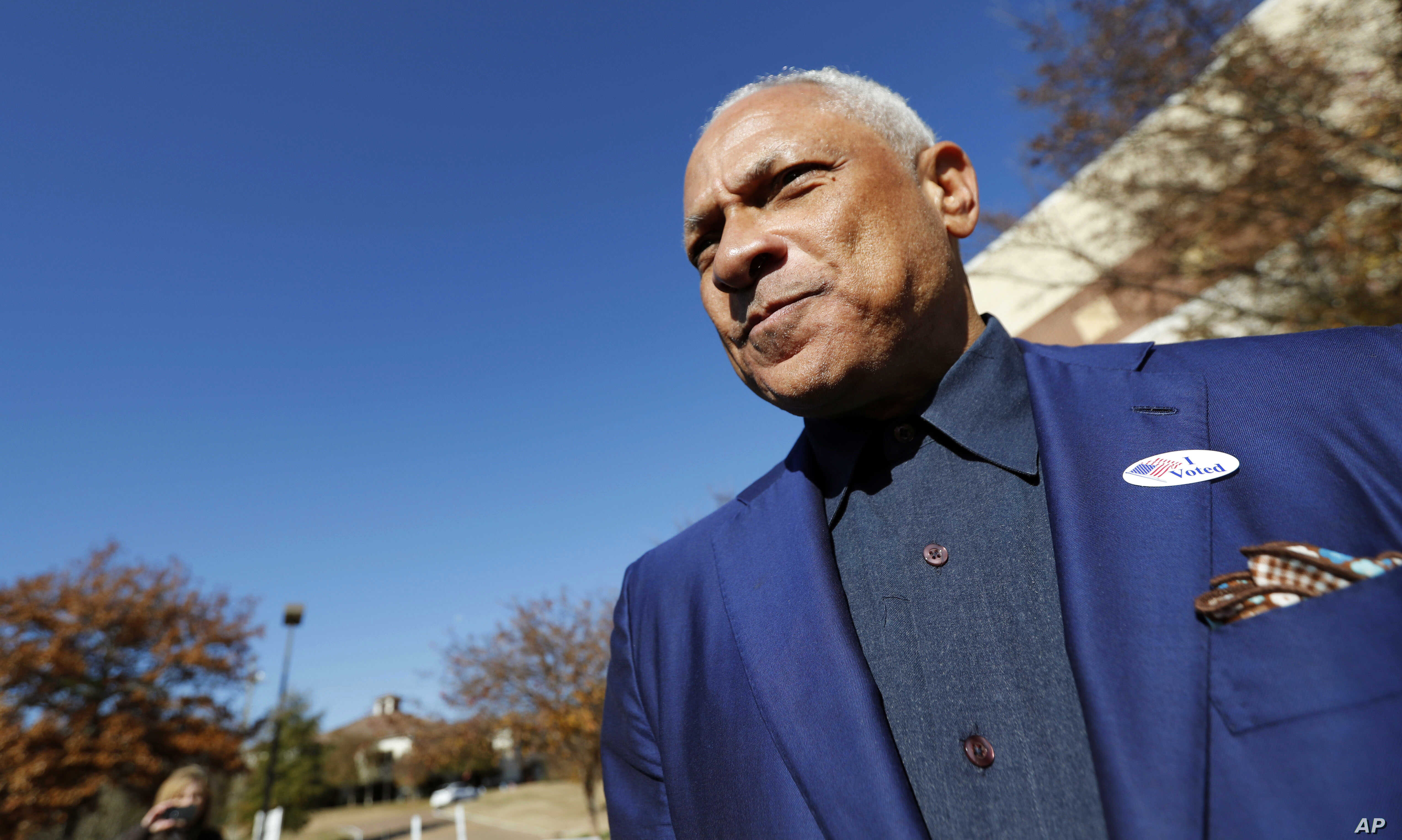 Democrat Mike Espy leaves his precinct after voting in a runoff election, Nov. 27, 2018 in Ridgeland, Mississippi.