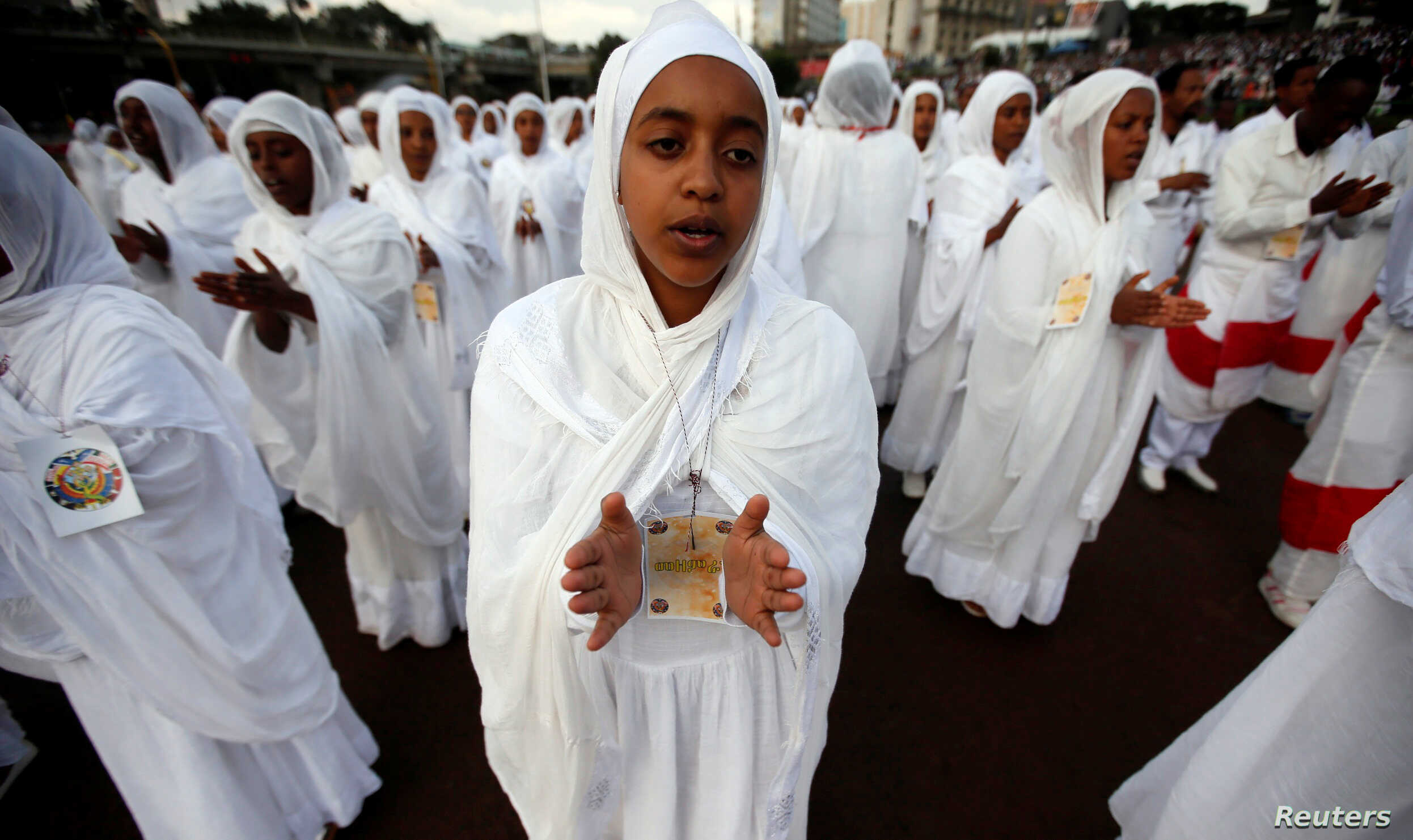 FILE - Sunday school children perform during the Meskel Festival to commemorate the discovery of the true cross on which Jesus Christ was crucified on at the Meskel Square in Ethiopia's capital Addis Ababa, Sept. 26, 2016.