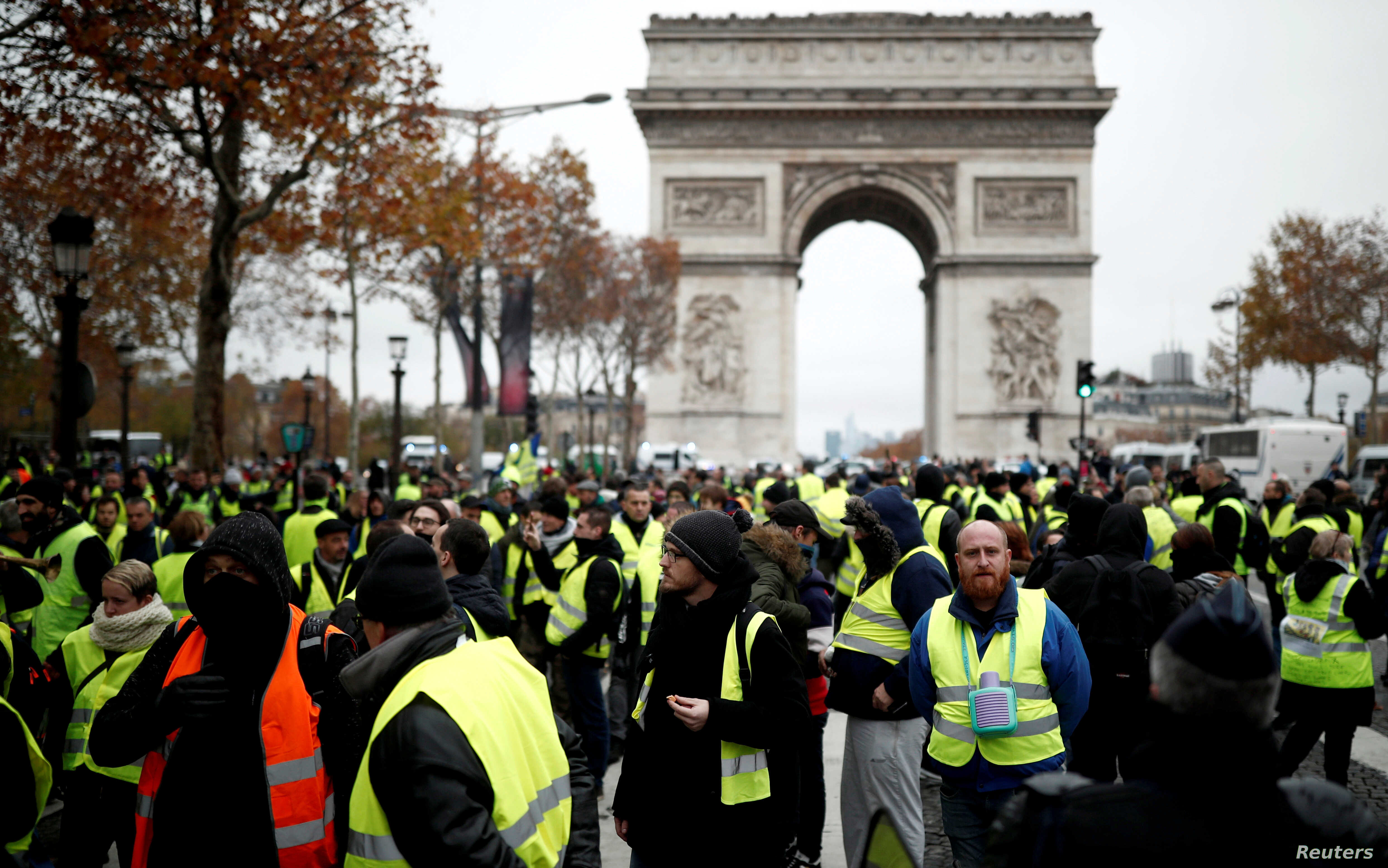 Protesters wearing yellow vests, a symbol of a French drivers' protest against higher fuel prices, block the Champs-Elysee in Paris, Nov. 24, 2018.