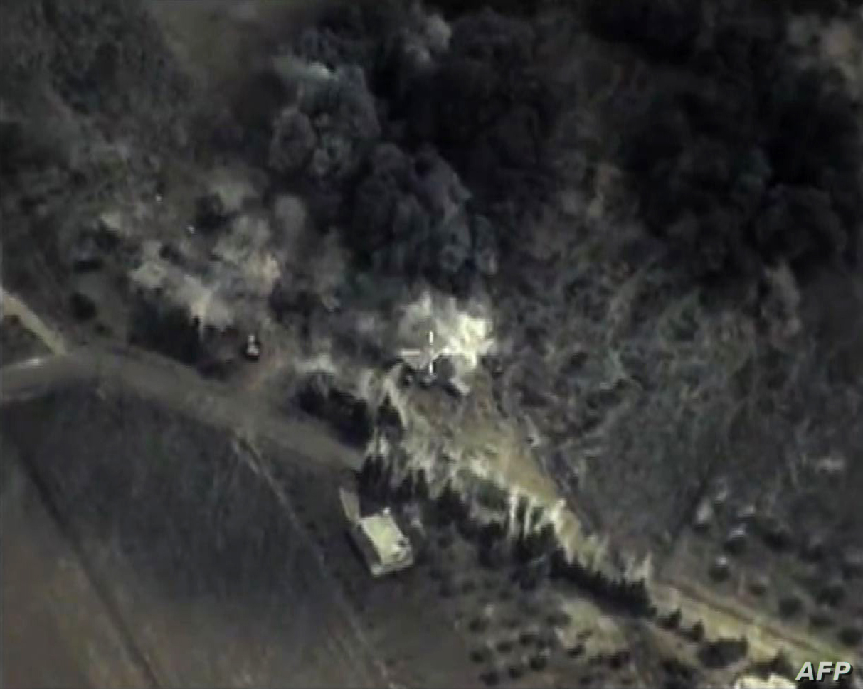 A video grab from Sept. 30, 2015, shows an image taken from footage made available on the Russian Defense Ministry's official website, purporting to show an airstrike in Syria.