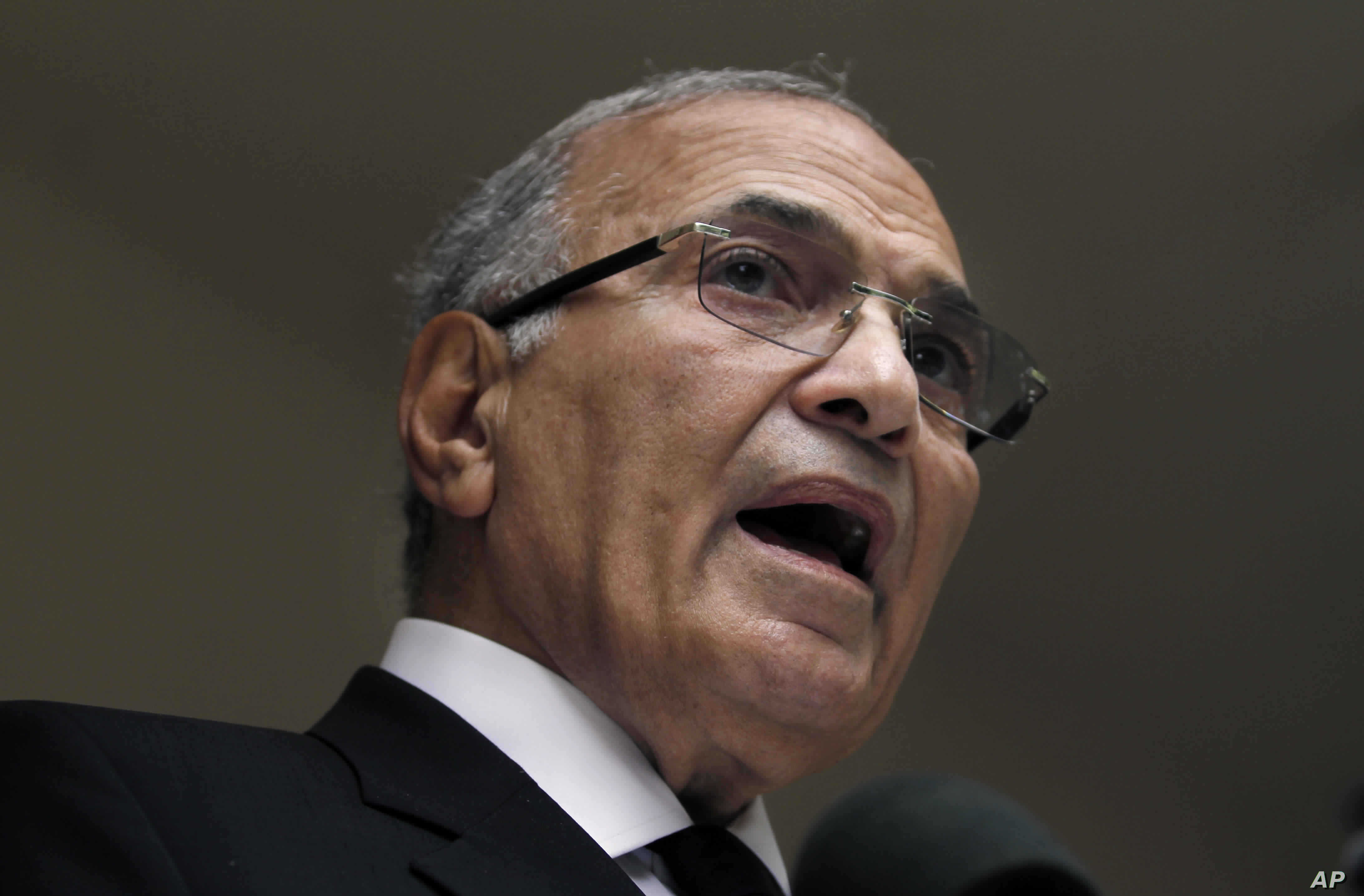 FILE - In this May 26, 2012 file photo, then Egyptian presidential candidate Ahmed Shafiq speaks during a press conference at his office in Cairo, Egypt.