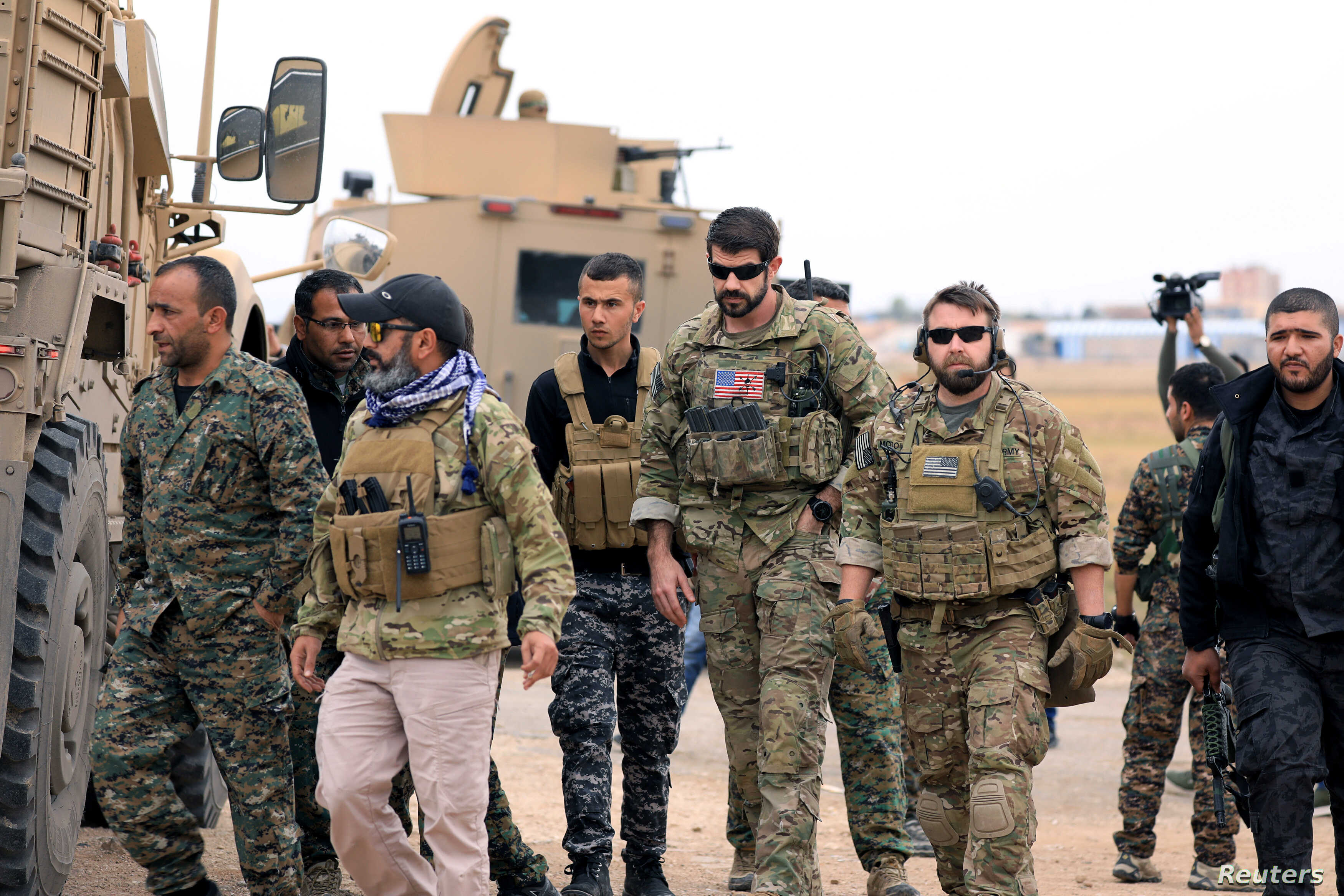 Syrian Democratic Forces and U.S. troops are seen during a patrol near Turkish border in Hasakah, Syria, Nov. 4, 2018.
