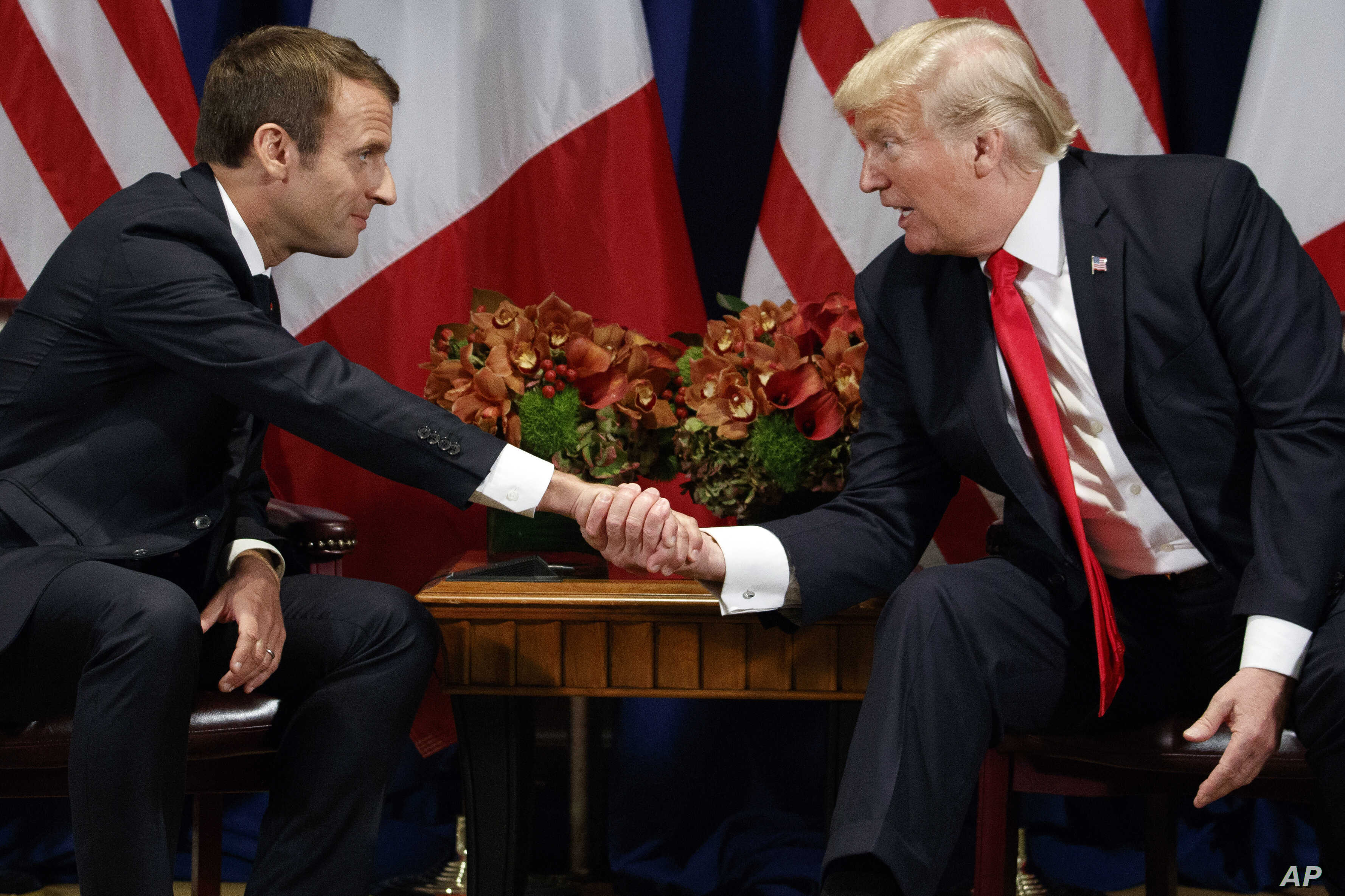 President Donald Trump shakes hands with French President Emmanuel Macron during a meeting at the Palace Hotel, Sept. 18, 2017, in New York.