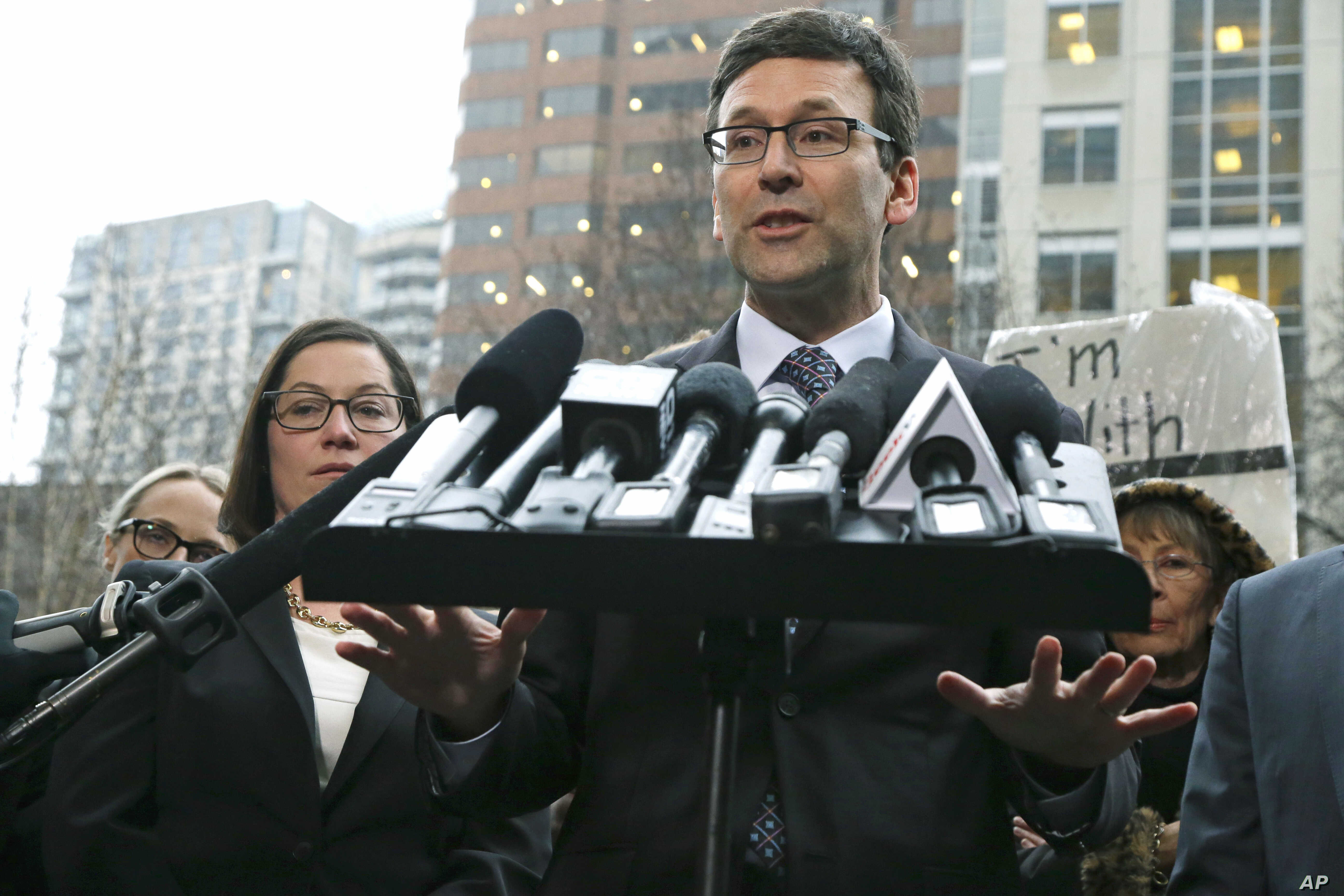 Washington Attorney General Bob Ferguson talks to reporters, Feb. 3, 2017, following a hearing in federal court in Seattle.