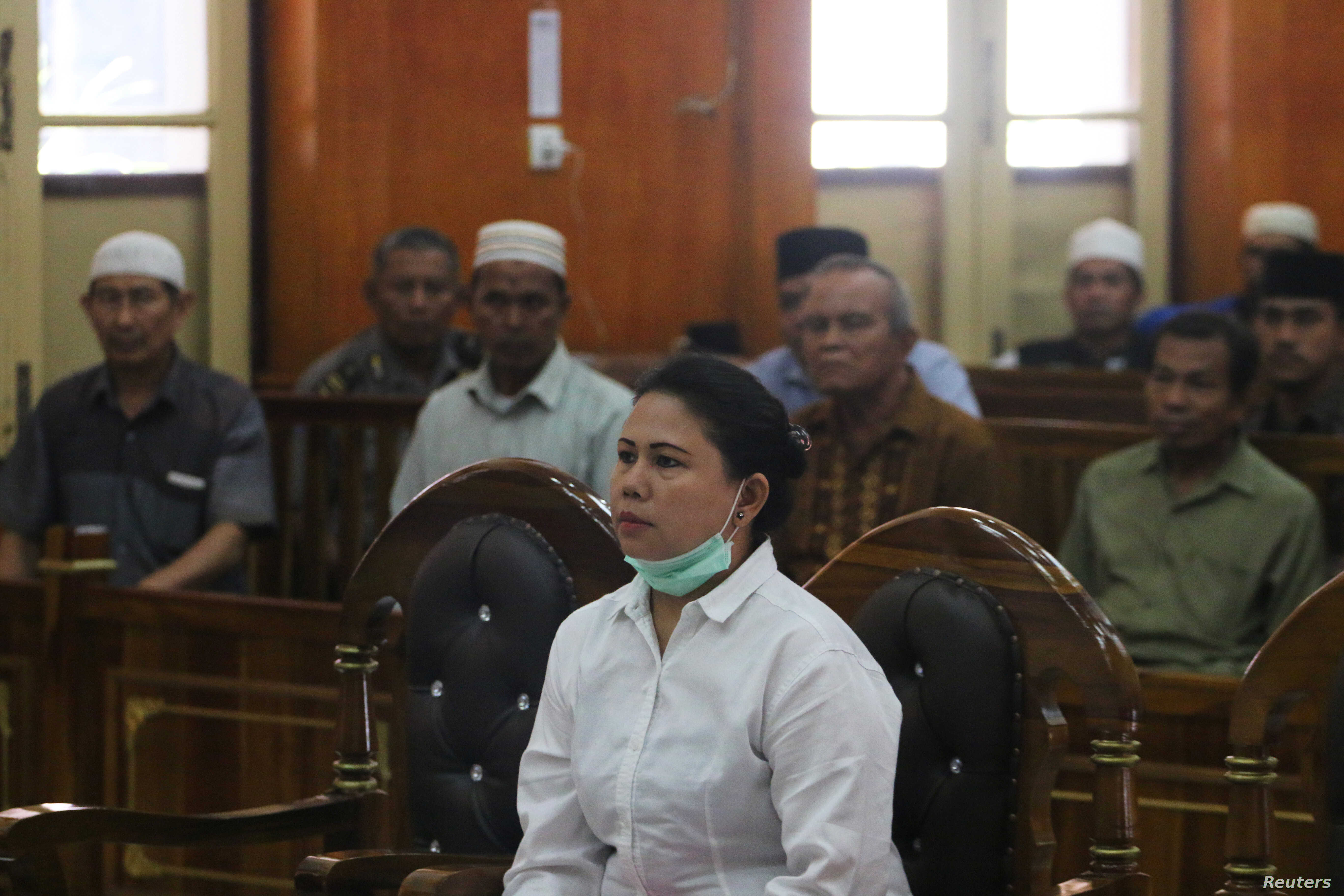 Meiliana, a 44-year-old ethnic Chinese Buddhist, sits in a courtroom for blasphemy charges, in Medan, Sumatra, Indonesia, Aug. 21, 2018.