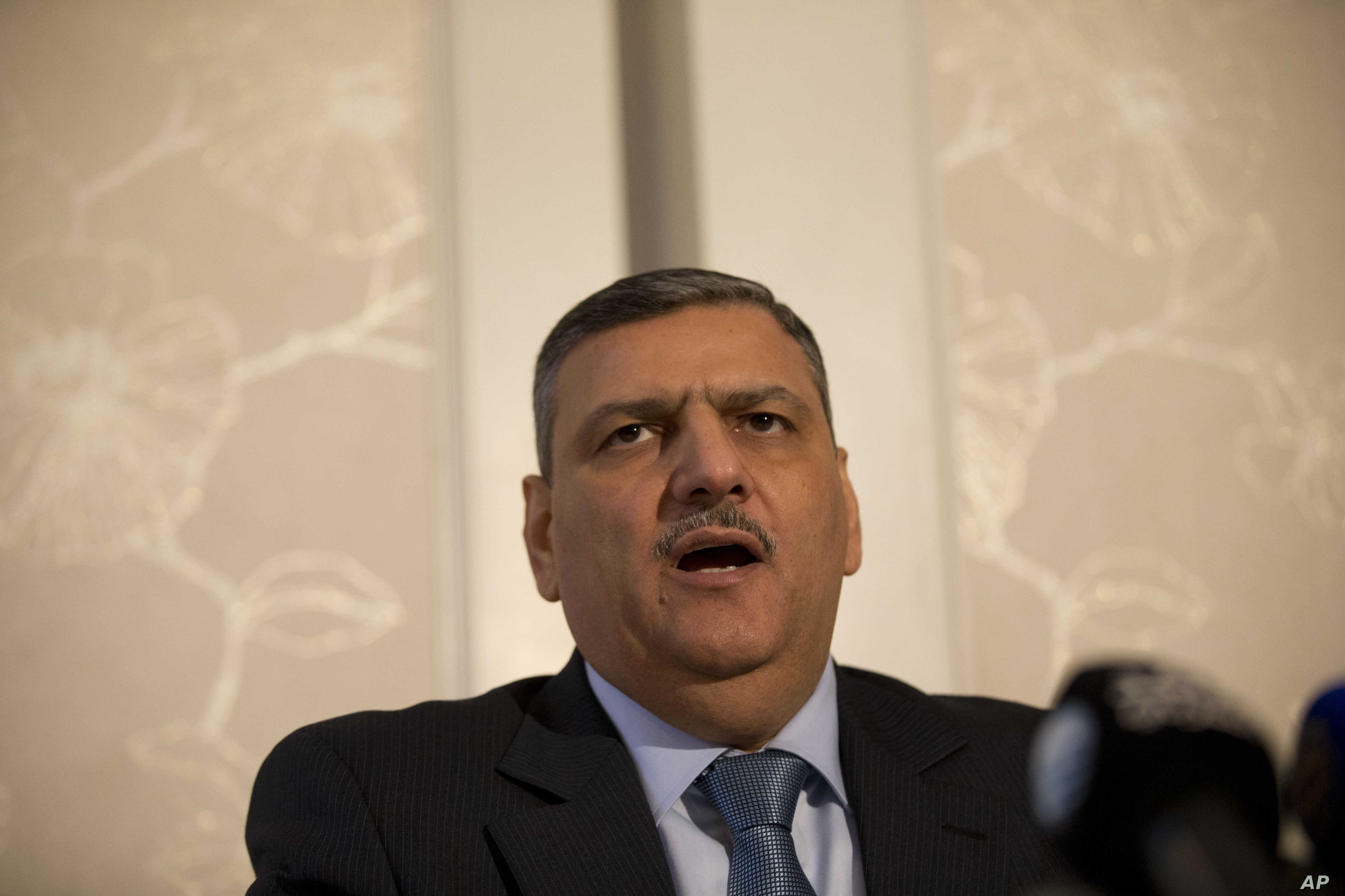 """Riyad Hijab, head of the Syrian opposition High Negotiations Committee, gives a press conference in London, Feb. 10, 2016. The committee said Hijab thinks the chances of reaching an agreement on a political transition in Syria are """"slim."""""""