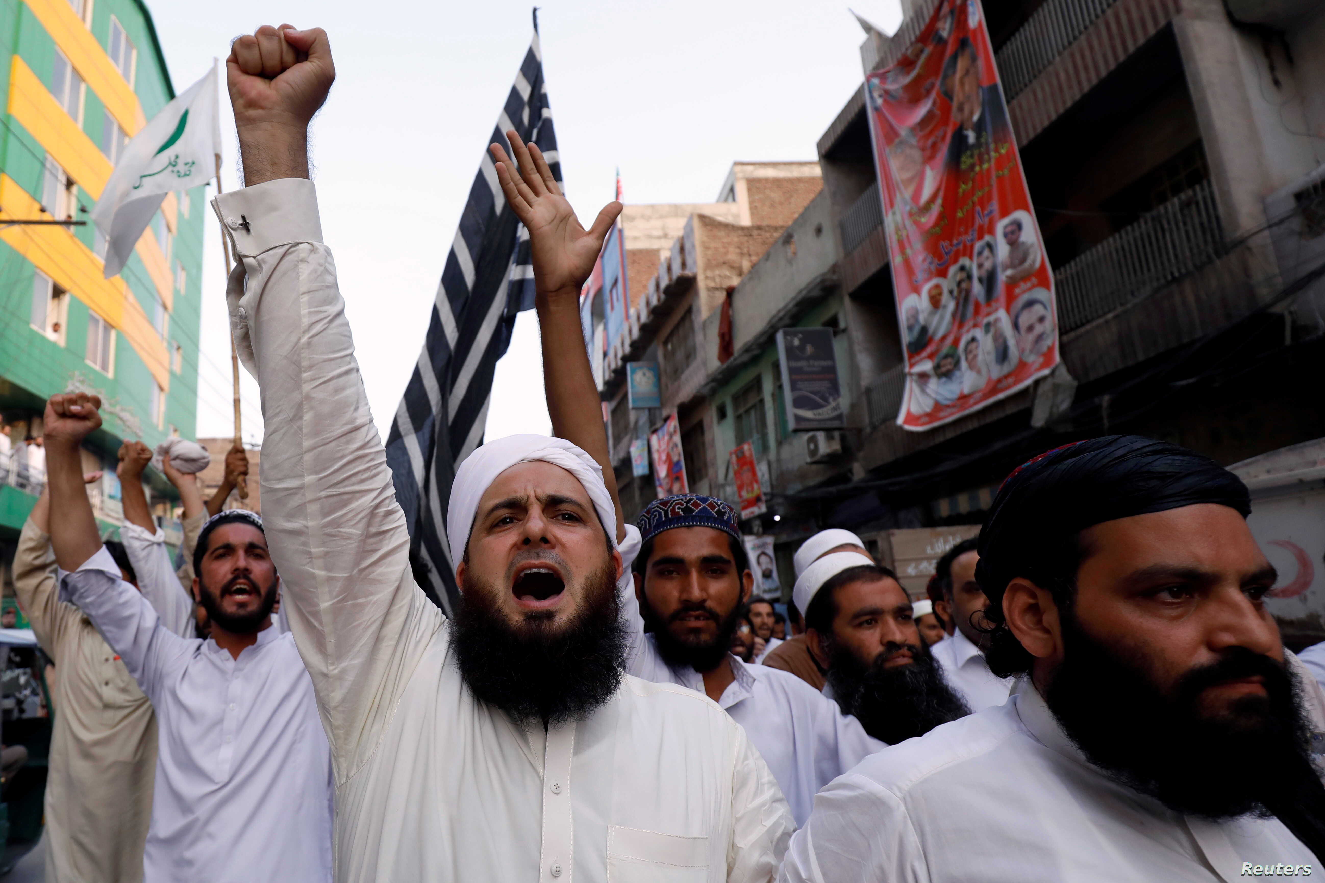 Supporters of the Muttahida Majlis-e-Amal (MMA), a coalition between religious-political parties, chant slogans against, what they say is alleged rigging by Election Commission of Pakistan (ECP) during general election, in Peshawar, Pakistan, July 27...