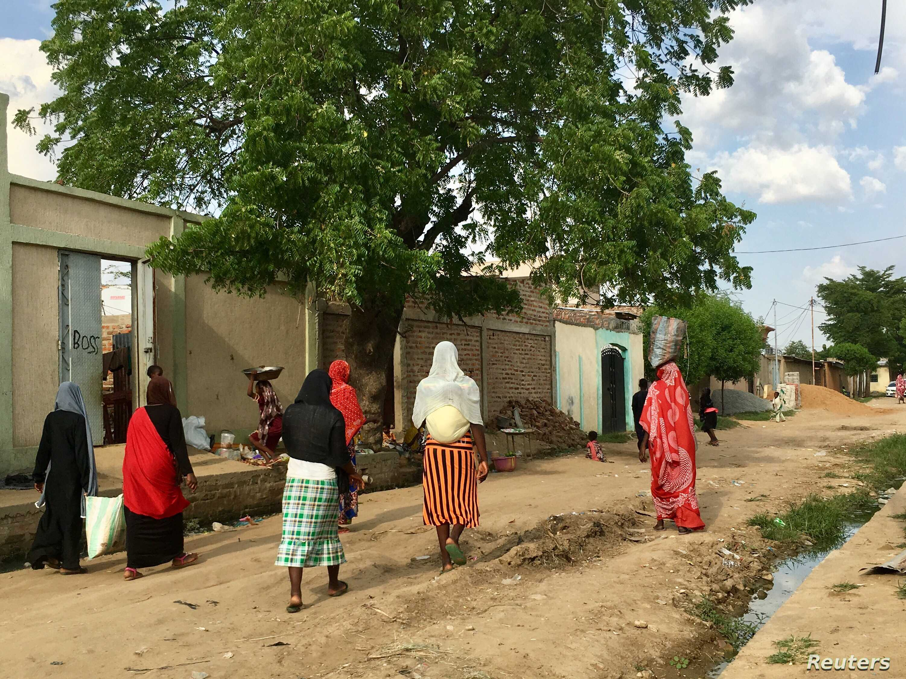 Women walking on a road in downtown N'Djamena, Chad, a country embroiled in a deep economic, security and humanitarian crisis, where state funding is scarce and not a single law assures any rights for disabled people, Sept. 23, 2017.