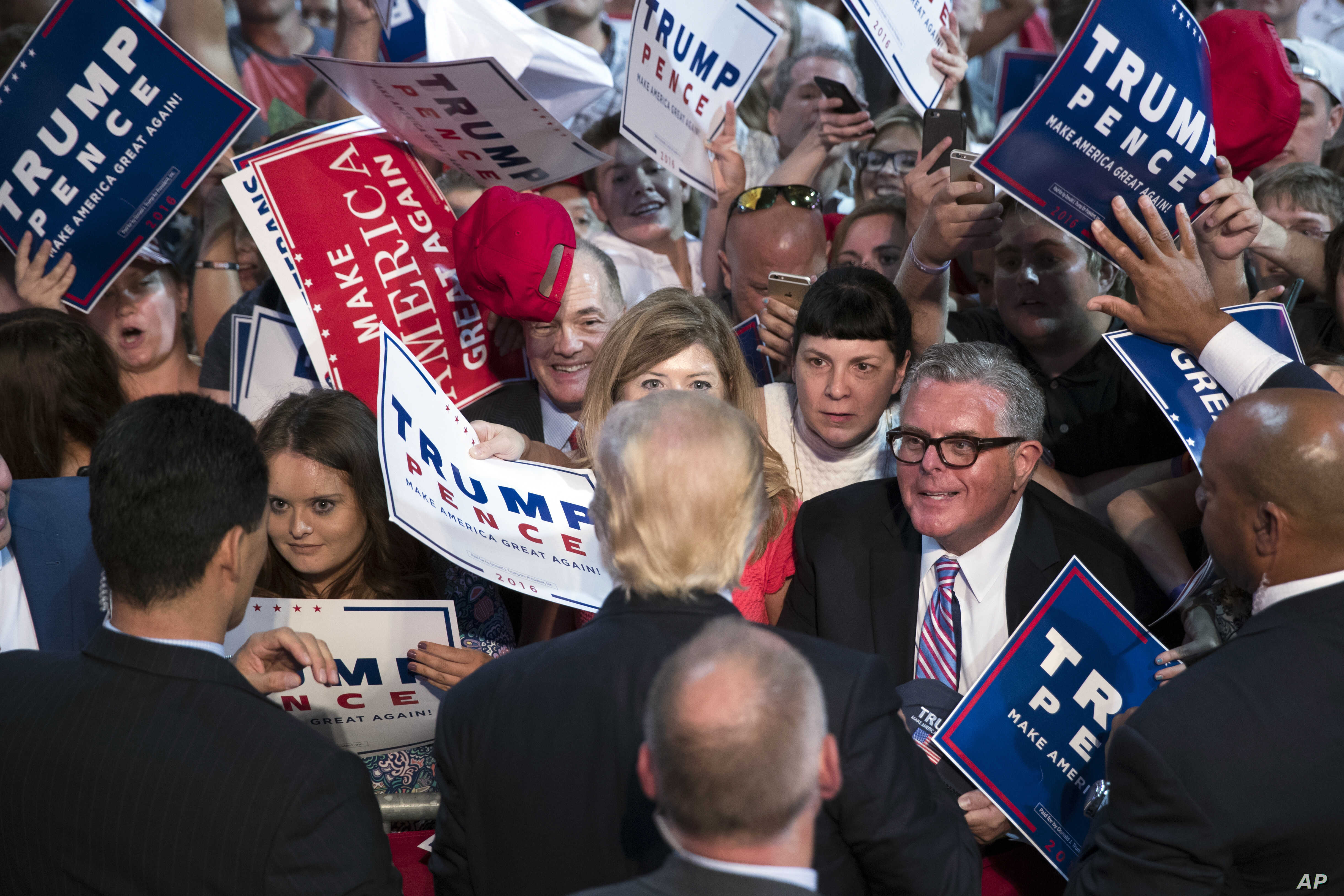 Supporters reach out for Republican presidential candidate Donald Trump during a campaign rally, July 27, 2016, in Toledo, Ohio.