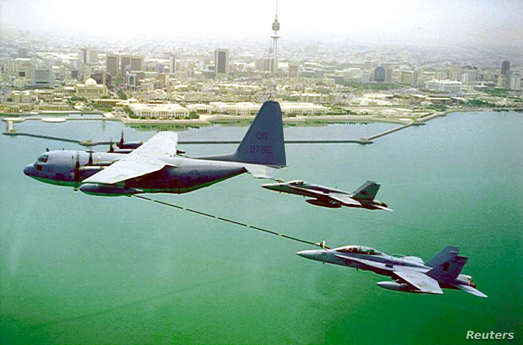 FILE - A U.S. Marine Corps KC-130 refuels two F/A-18 fighter planes as they soar high above Kuwait, Dec. 22, 2000. The KC-130 is a Marine Corps aircraft. It is a refueling version of the C-130 military cargo plane and can also be used to carry passen...