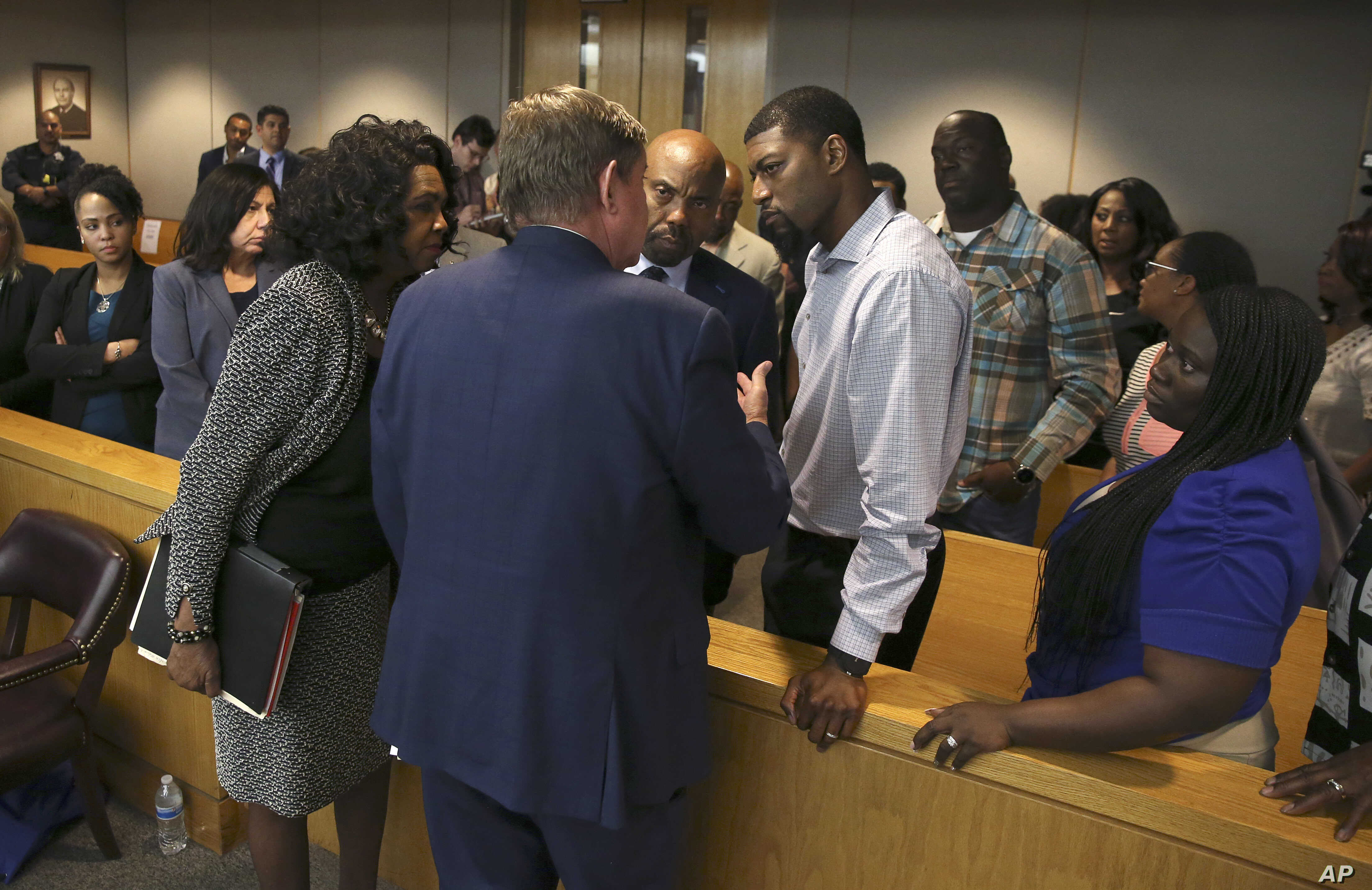 Lead prosecutor Michael Snipes, second from left, and Dallas County DA Faith Johnson, left, talk to Odell and Charmaine Edwards after  Roy Oliver was sentenced to 15 years in prison for the murder of their son Jordan Edwards, Aug. 29, 2018, in Dallas...