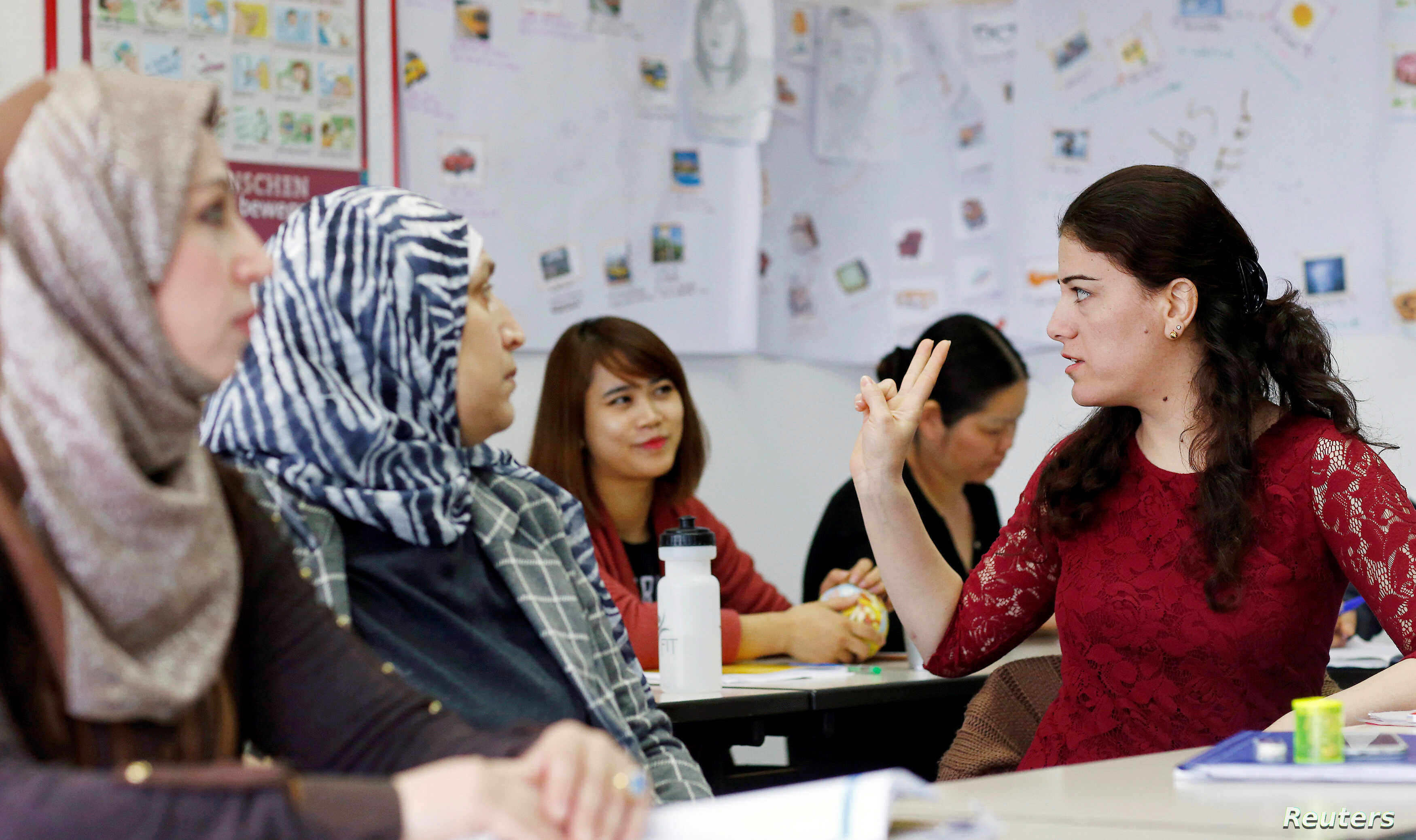 """FILE - Migrants attend a lesson at the """"institute for intercultural communication"""" in Berlin, Germany, April 13, 2016."""