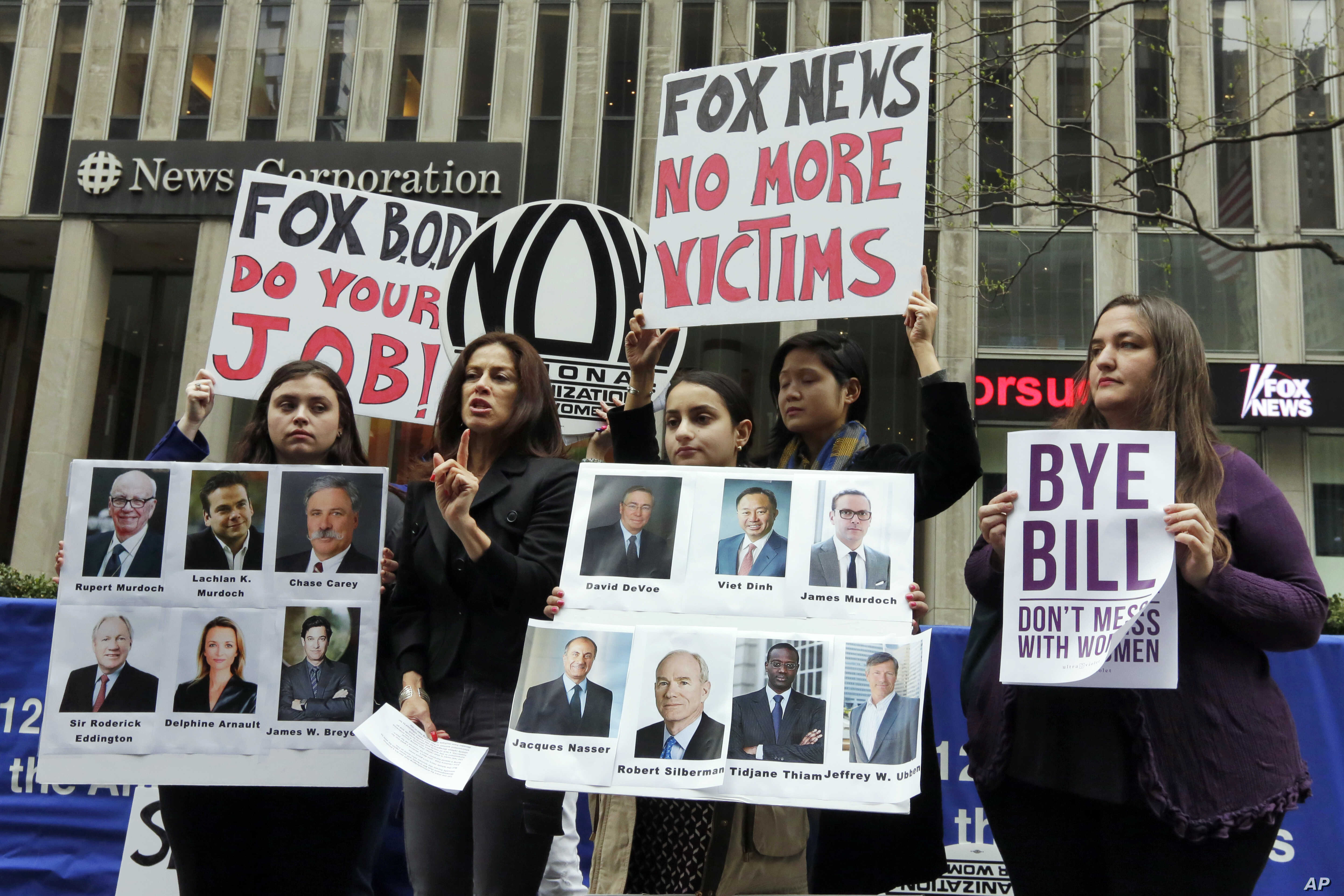 Sonia Ossorio, second left, president of the National Organization for Women New York, speaks outside the News Corporation headquarters in New York, April 20, 2017, a day after Fox News Channel's Bill O'Reilly was fired.
