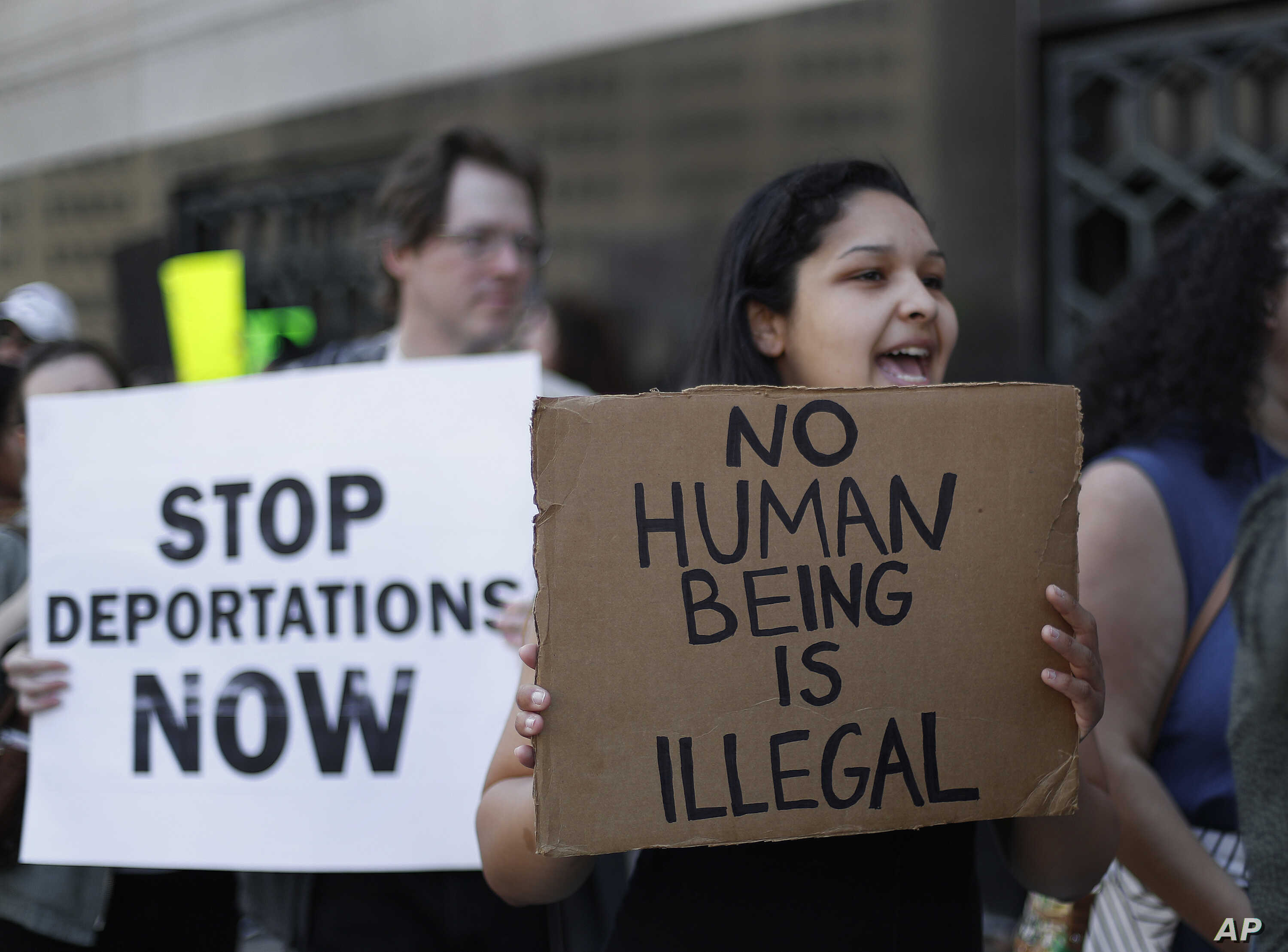 FILE - protesters rally outside a federal courthouse in Detroit. Protesters rallied in hopes public outcry will again delay the deportation of Jose Luis Sanchez-Ronquillo from the United States to Mexico.