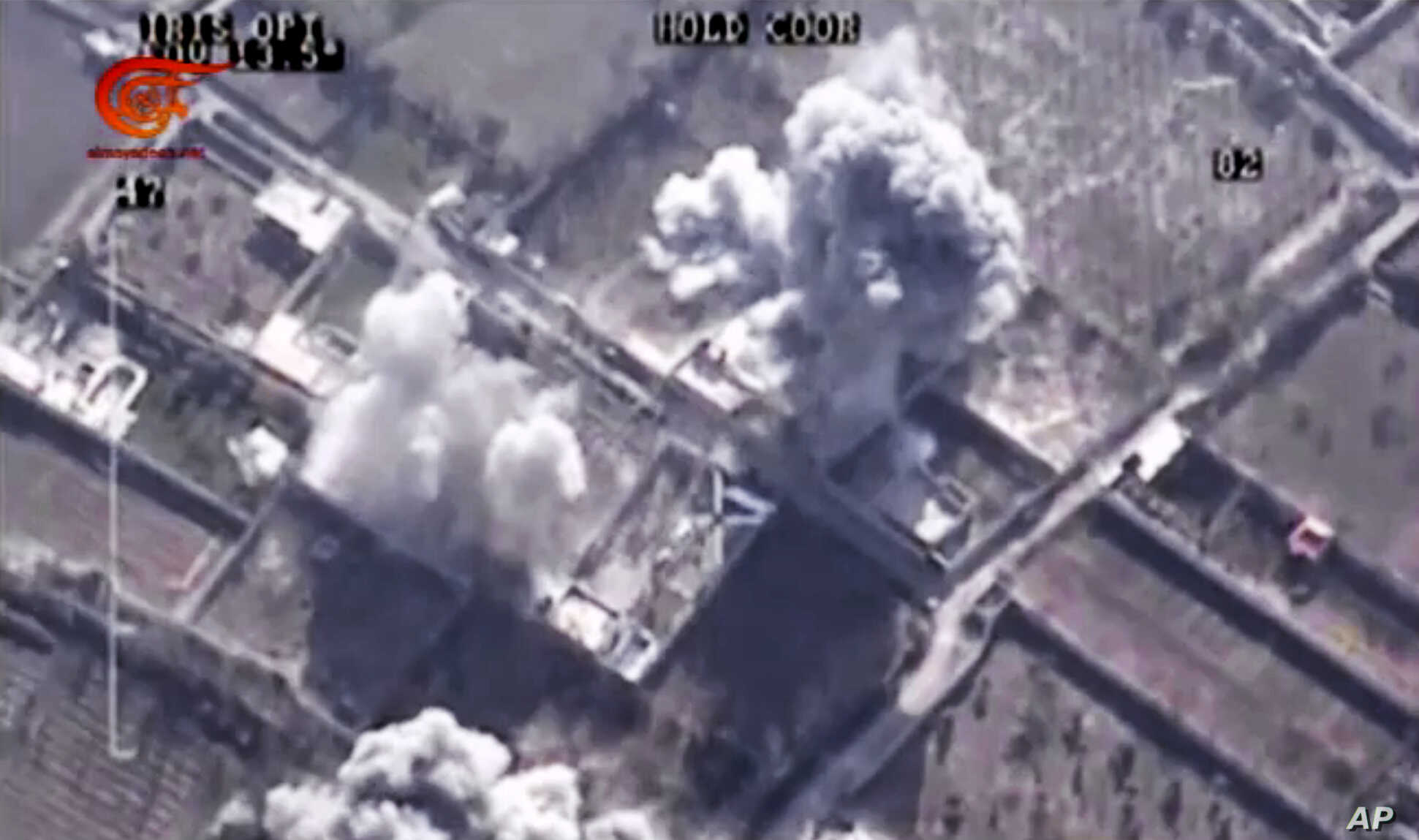 This image made from video of drone footage allegedly showing Syrian army airstrikes targeting Zahran Allouch, the head of the Army of Islam group near Damascus, Syria, Dec. 25, 2015.