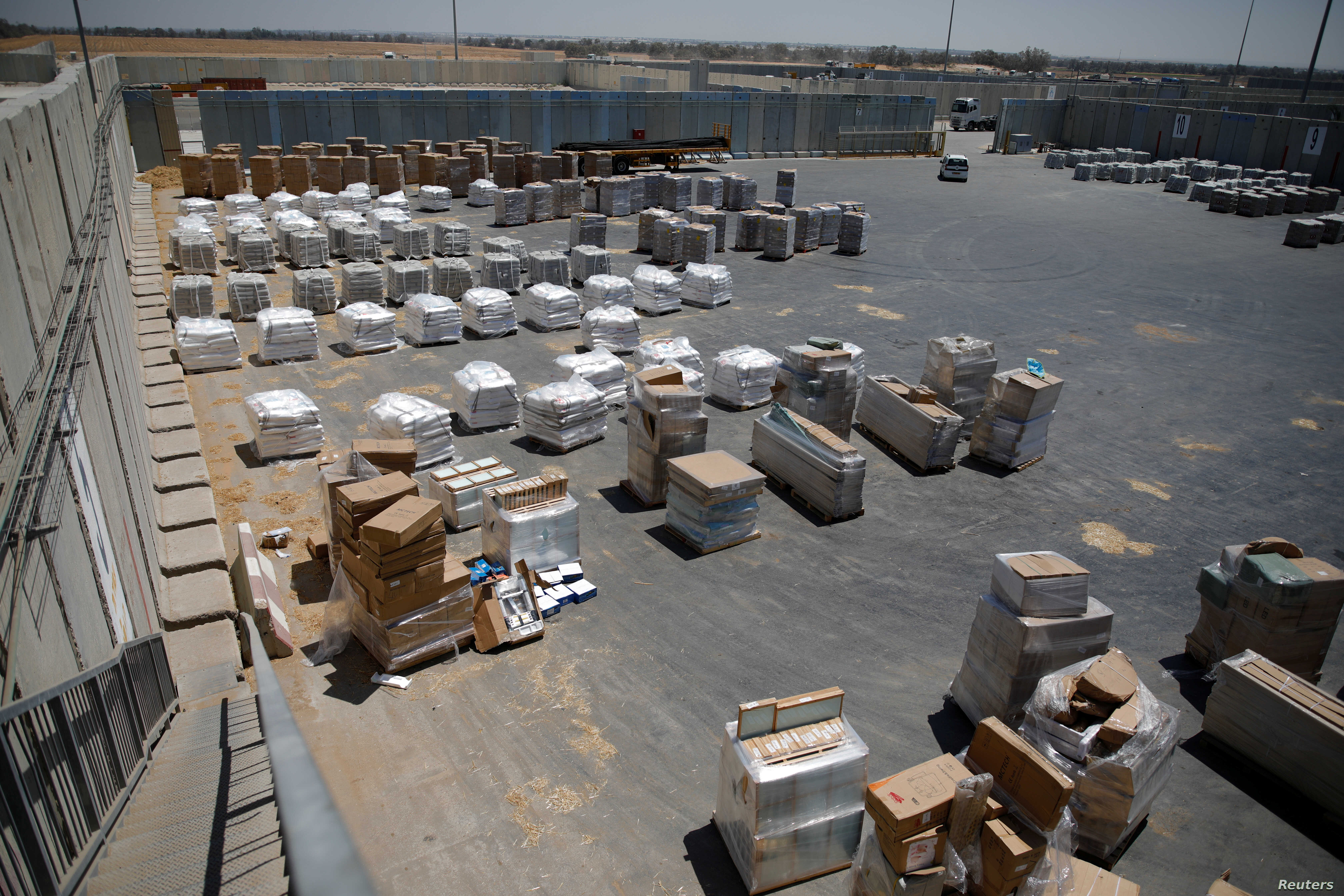 Packages of goods are seen ahead of their transfer to the Gaza Strip, inside the Kerem Shalom border crossing terminal between Israel and Gaza Strip, Israel, Aug. 15, 2018.