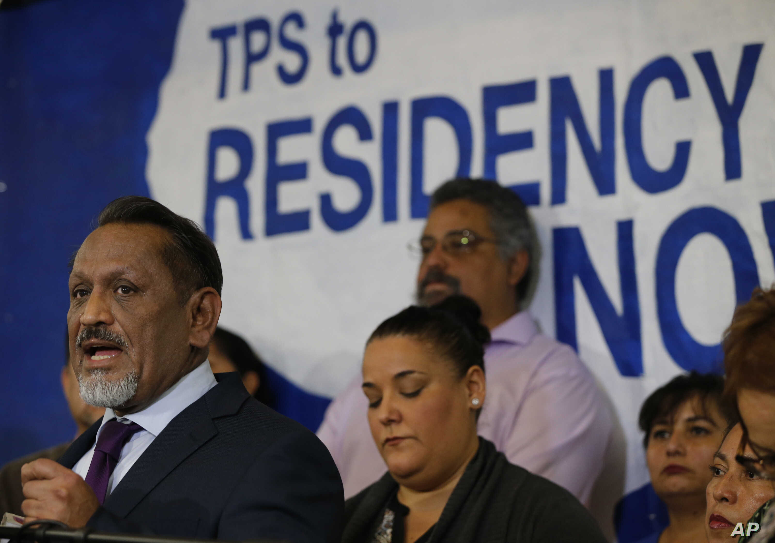Los Angeles City Council member Gil Cedillo, far left, speaks following an announcement on the fate of Temporary Protected Status for nationals of El Salvador, in Los Angeles, Jan. 8, 2018.