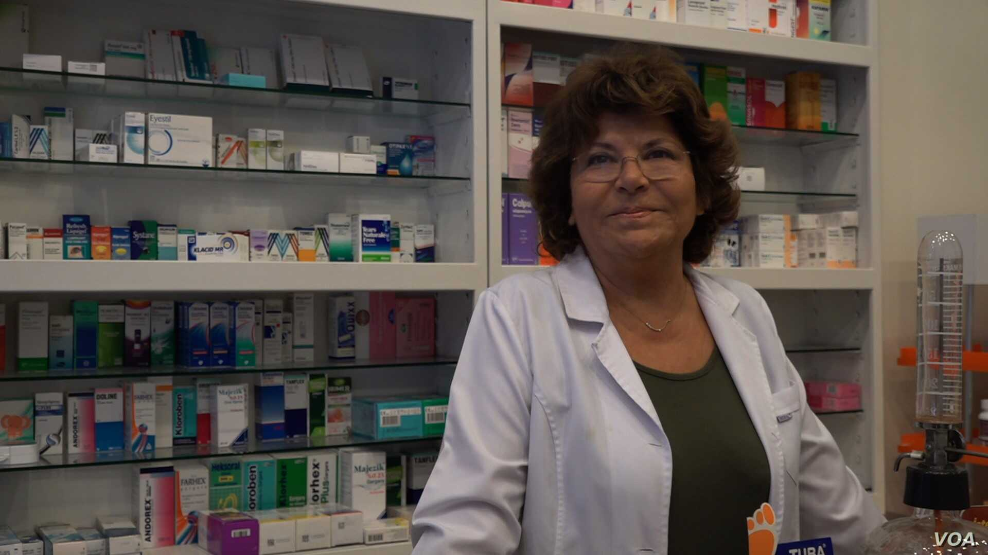 Pharmacist owner Guliz Kaptan worries about Turkey's heavy dependence on imported medicine amid the nation's currency crisis. (D. Jones/VOA News)