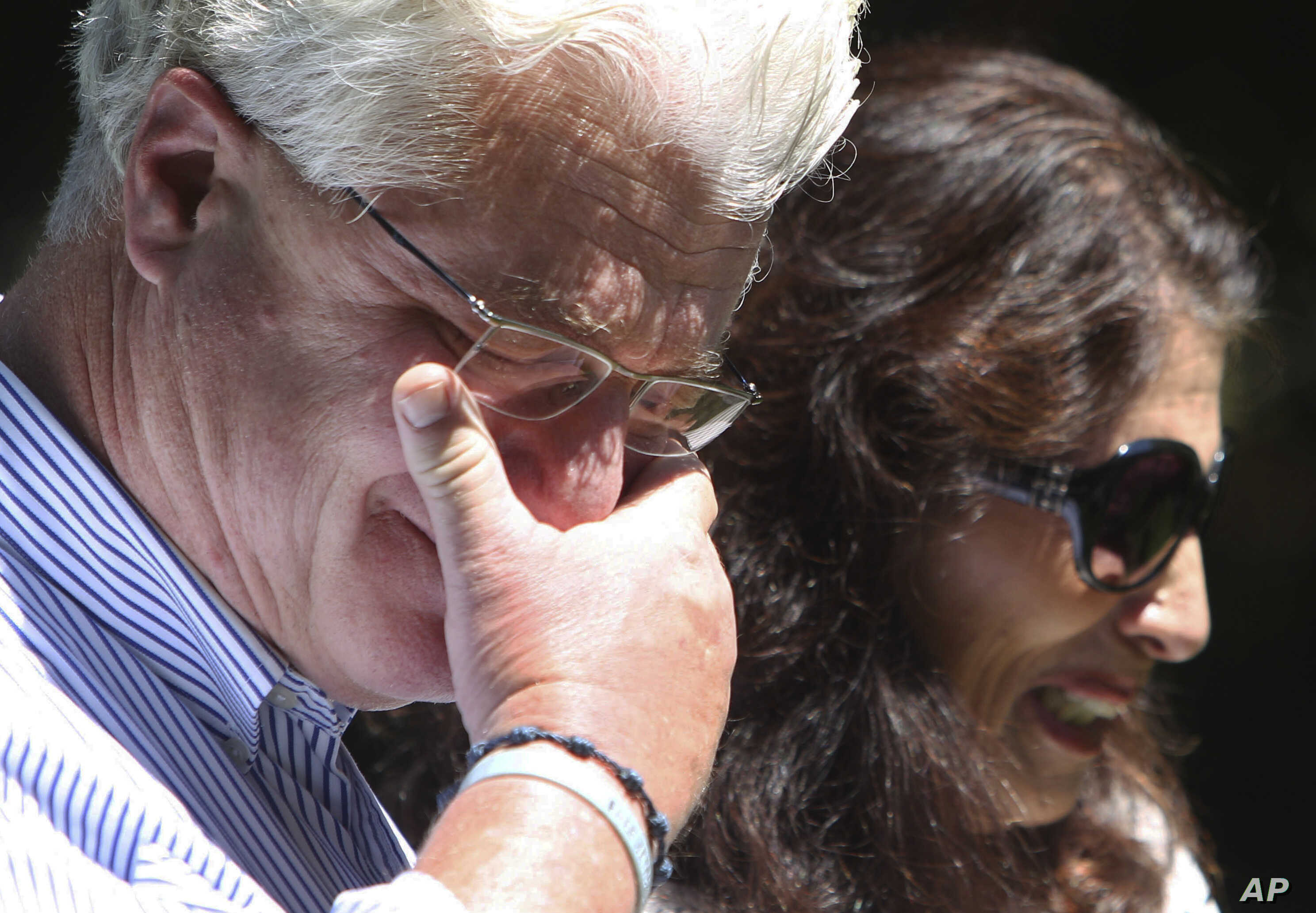 After speaking with U.S. President Barack Obama by phone, John and Diane Foley talk to reporters outside their home in Rochester, N.H, Aug. 20, 2014.