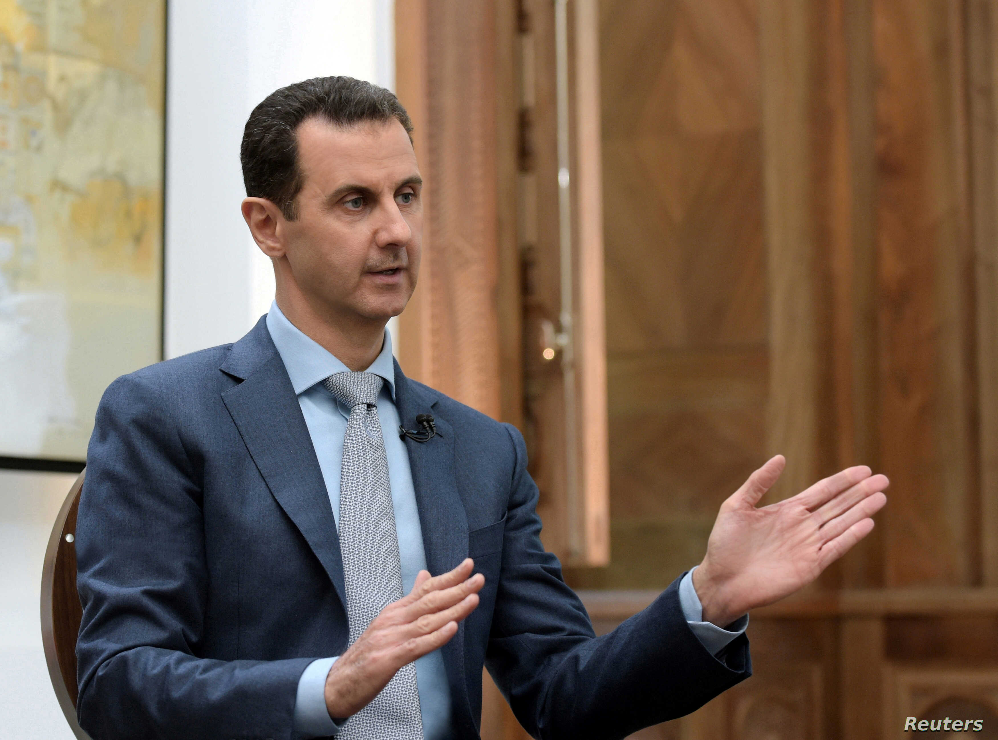 Syria's President Bashar al-Assad is interviewed Feb. 10, 2017, in Syria. Thousands of Afghans from Iran are involved in the Syrian conflict, many sent against their will, Human Rights Watch reports.