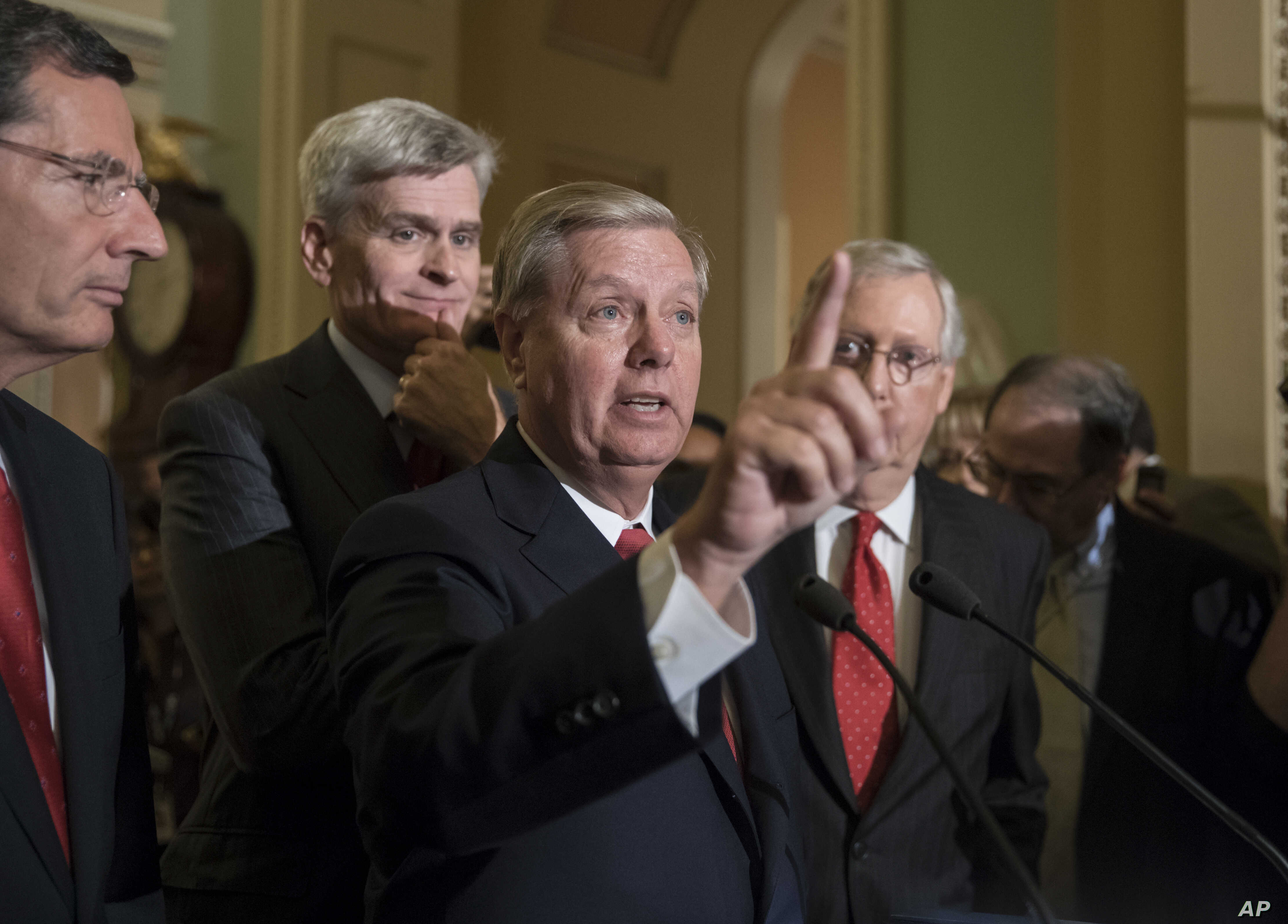 FILE - Sen. Lindsey Graham, R-S.C., joined by, from left, Sen. John Barrasso, R-Wyo., Sen. Bill Cassidy, R-La., and Senate Majority Leader Mitch McConnell, R-Ky., speaks to reporters as they faced assured defeat on the Graham-Cassidy bill, the GOP's ...