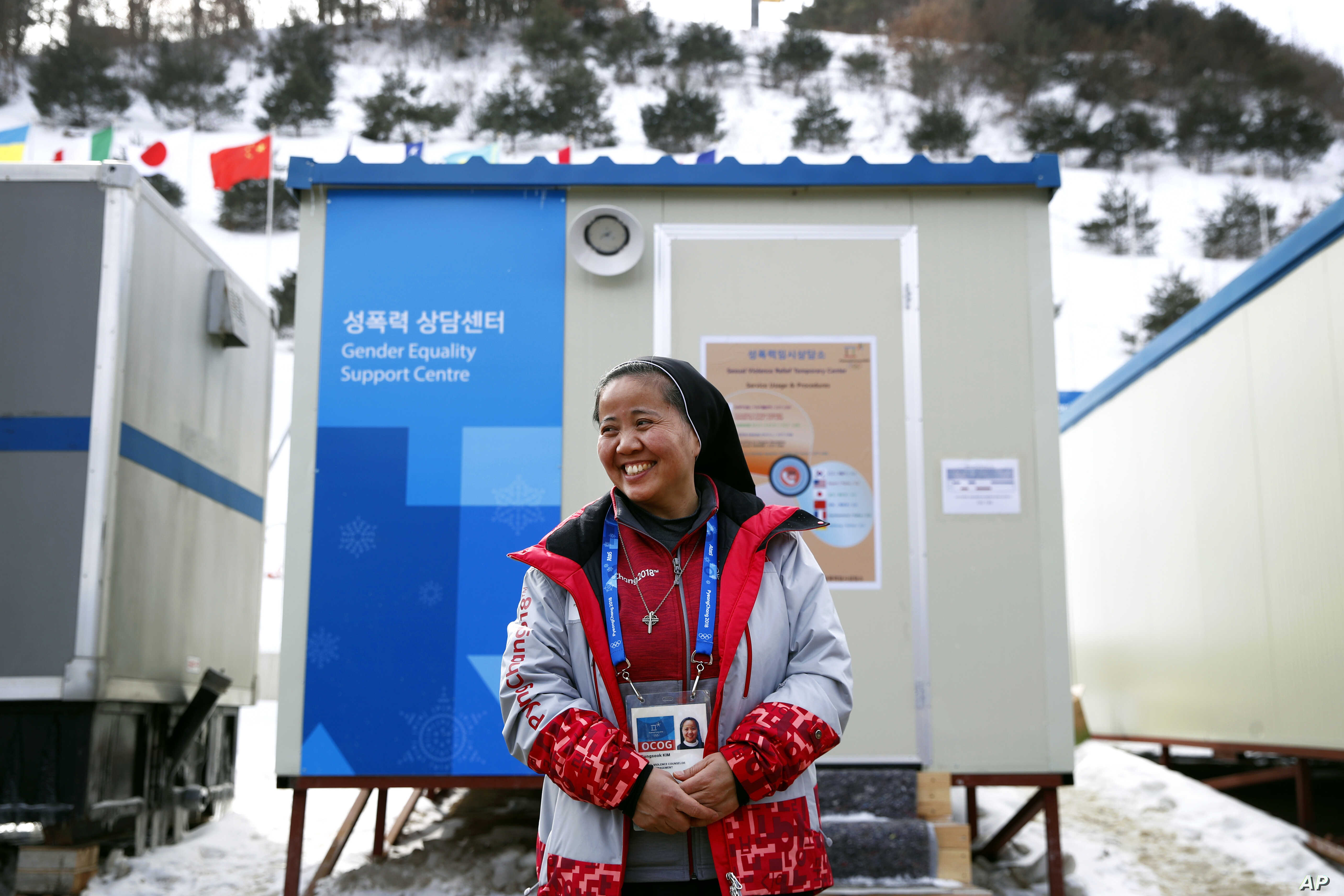 In this Feb. 12, 2018 photo, Sungsook Kim, a Catholic nun who goes by her religious name, Sister Droste, poses for a photograph outside her trailer office, the Gender Equality Support Center, at Phoenix Snow Park.