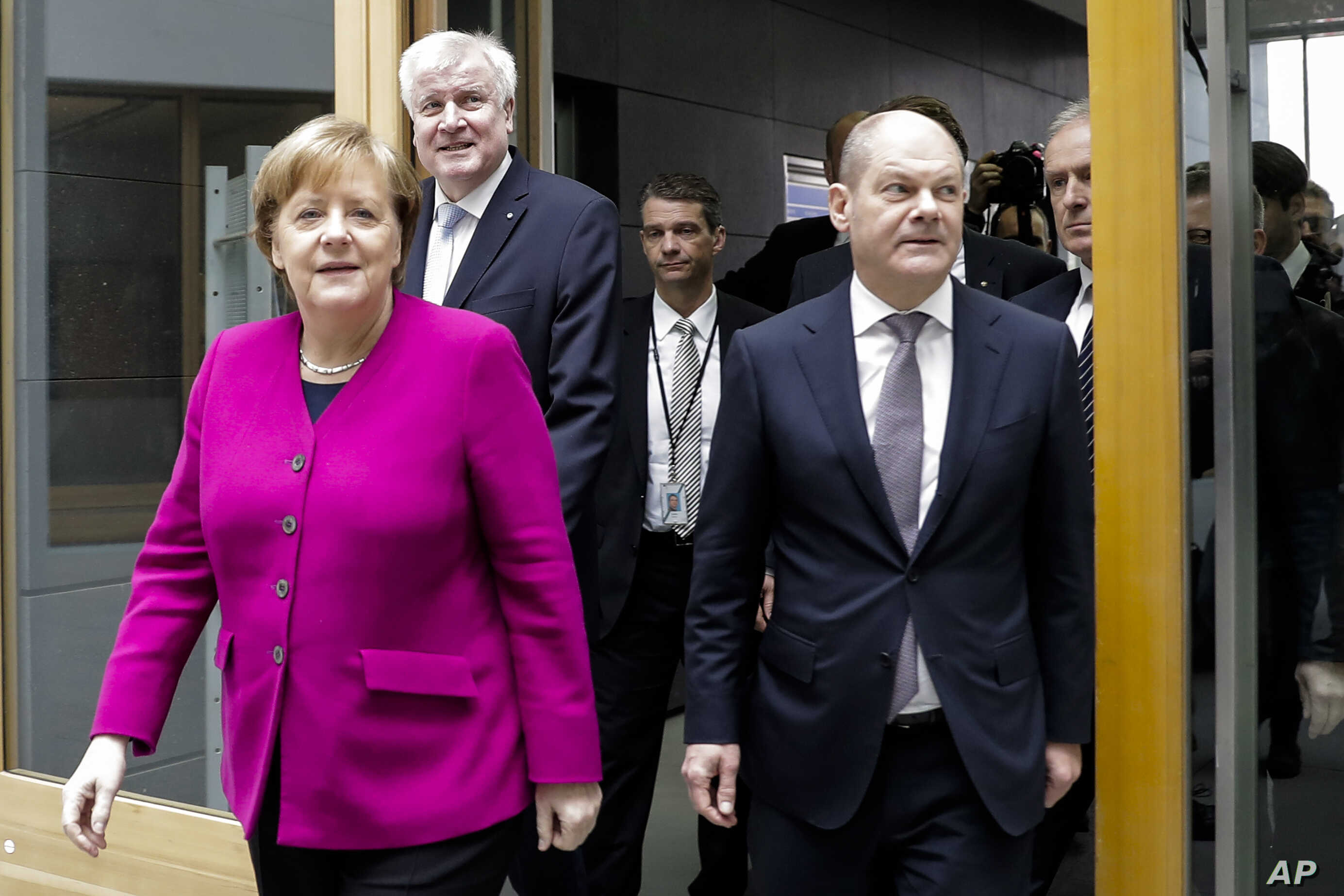 German Chancellor and Christian Democratic Union, CDU, party chairwoman Angela Merkel, left, Christian Social Union, CSU, party chairman Horst Seehofer, second from left, and Social Democratic Party, SPD temporary party leader Olaf Scholz, right, arr...