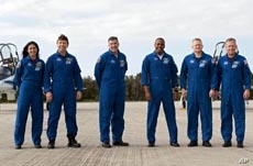 At NASA's Kennedy Space Center in Florida, space shuttle Discovery's STS-133 crew on the Shuttle Landing Facility runway.