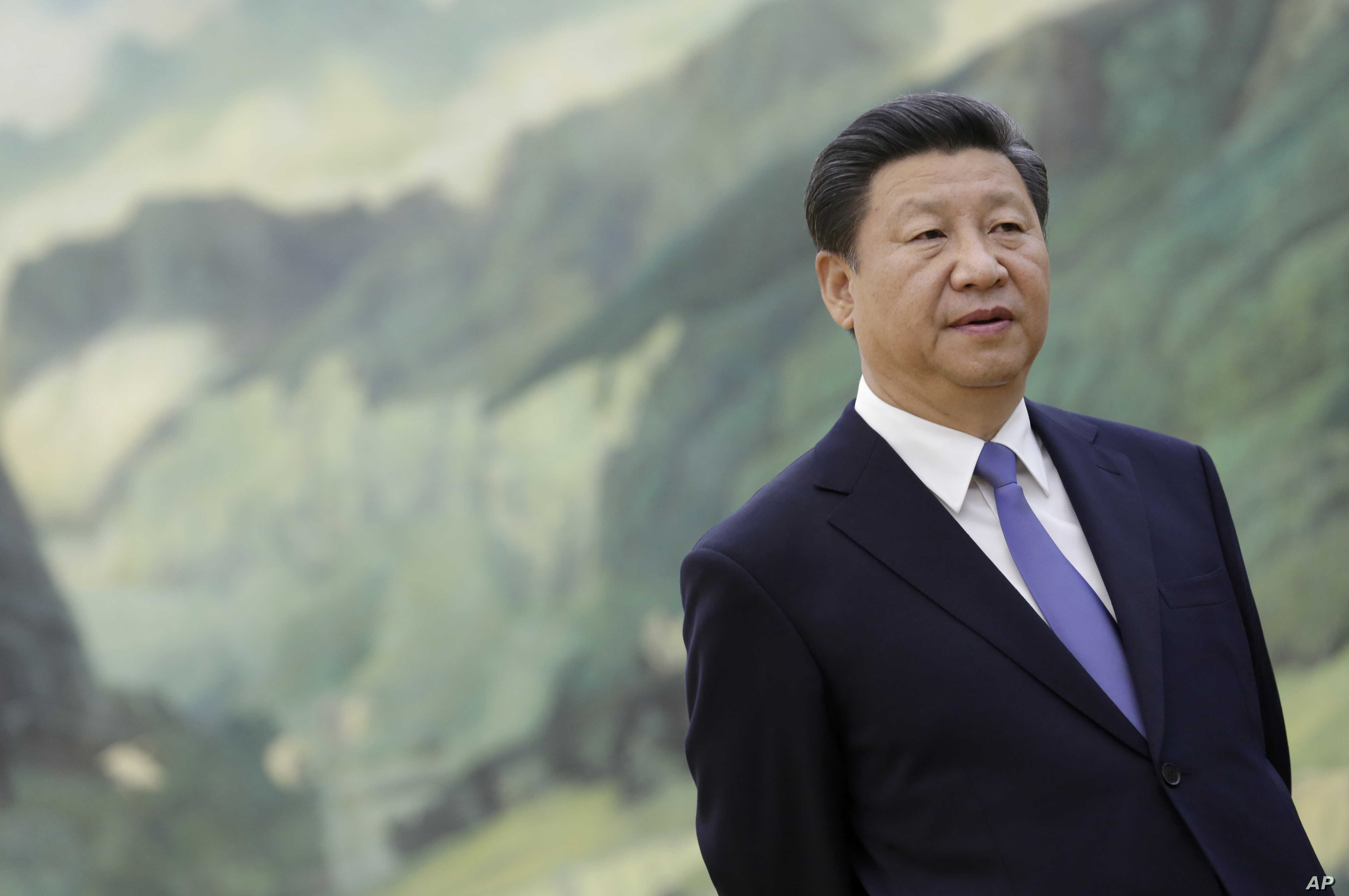 Chinese President Xi Jinping stands during a meeting with U.S. National Security Advisor Susan Rice at the Great Hall of the People in Beijing Aug. 28, 2015.