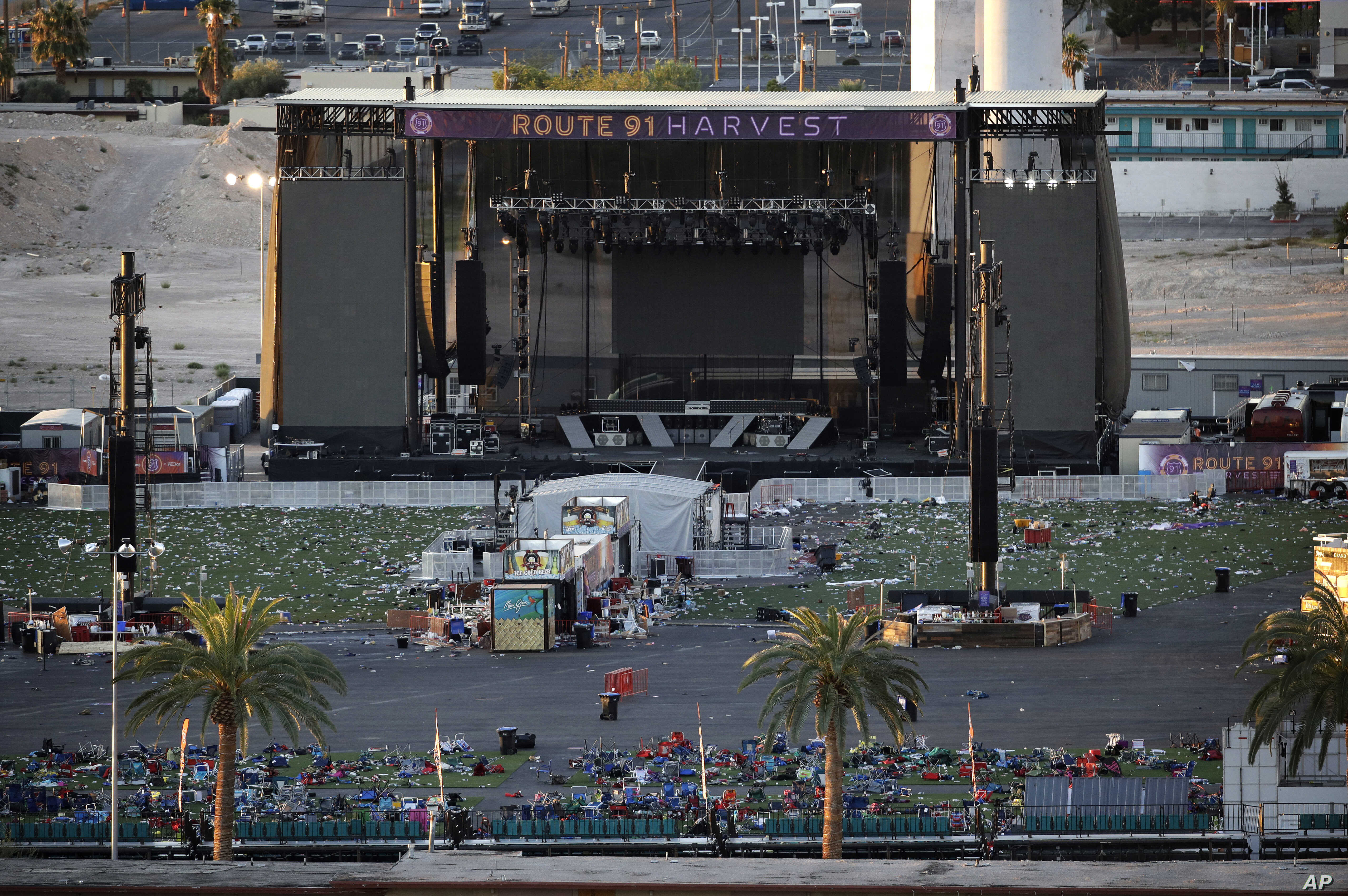 Debris litters the festival grounds across the street from the Mandalay Bay Resort and Casino, Oct. 3, 2017, in Las Vegas. Authorities said Stephen Craig Paddock, perched in the resort's hotel, used a cache of weapons to kill dozens and injure hundre...
