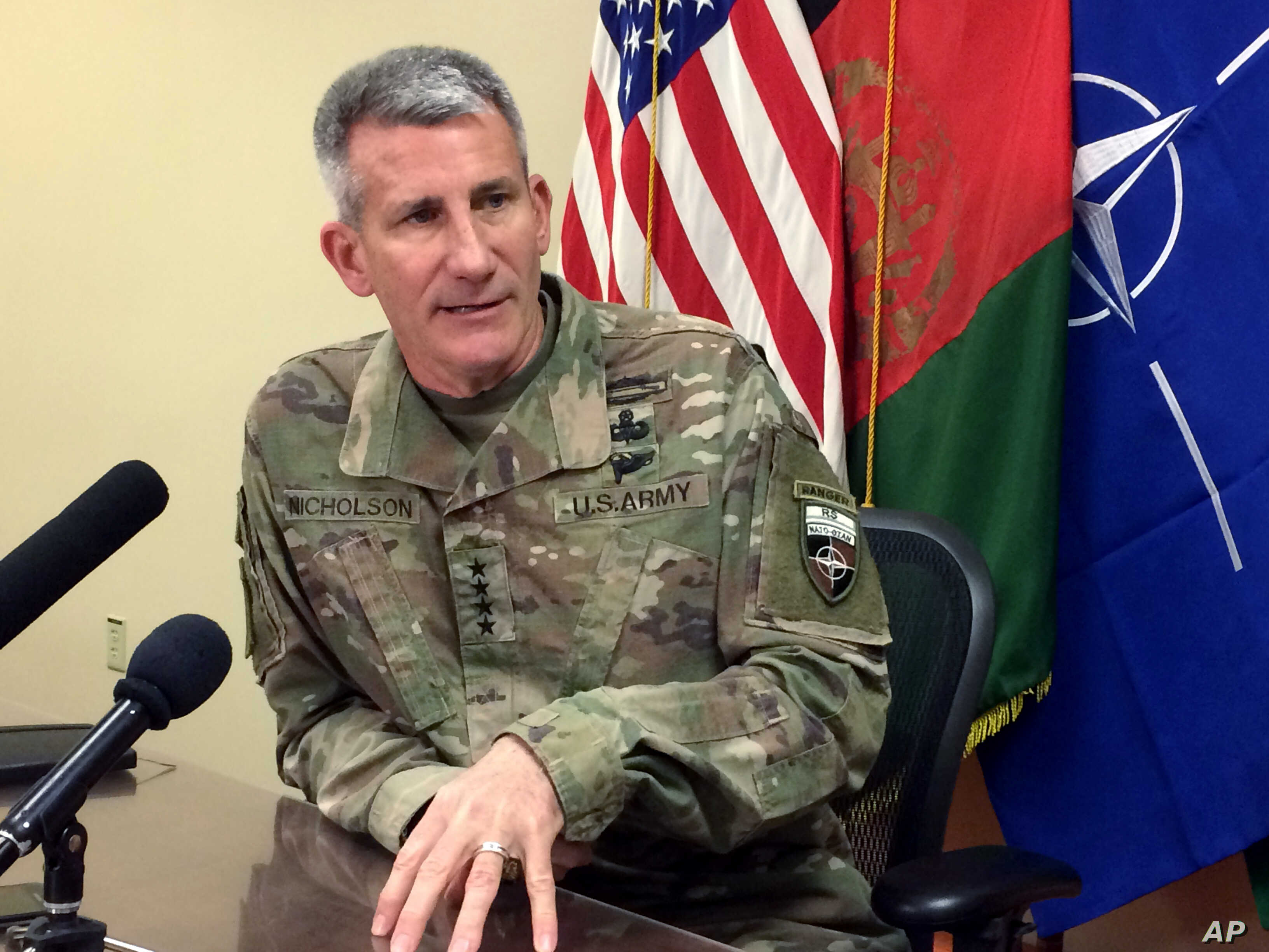 FILE - Gen. John Nicholson, the top American commander in Afghanistan, speaks to reporters, March 14, 2018, at Bagram air base north of Kabul, Afghanistan.