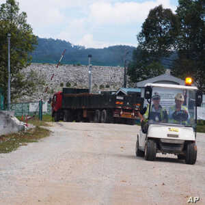 Truckloads of radioactive waste are still being taken to bury beneath the granite wall today, although the rare earth mining factory has closed down.