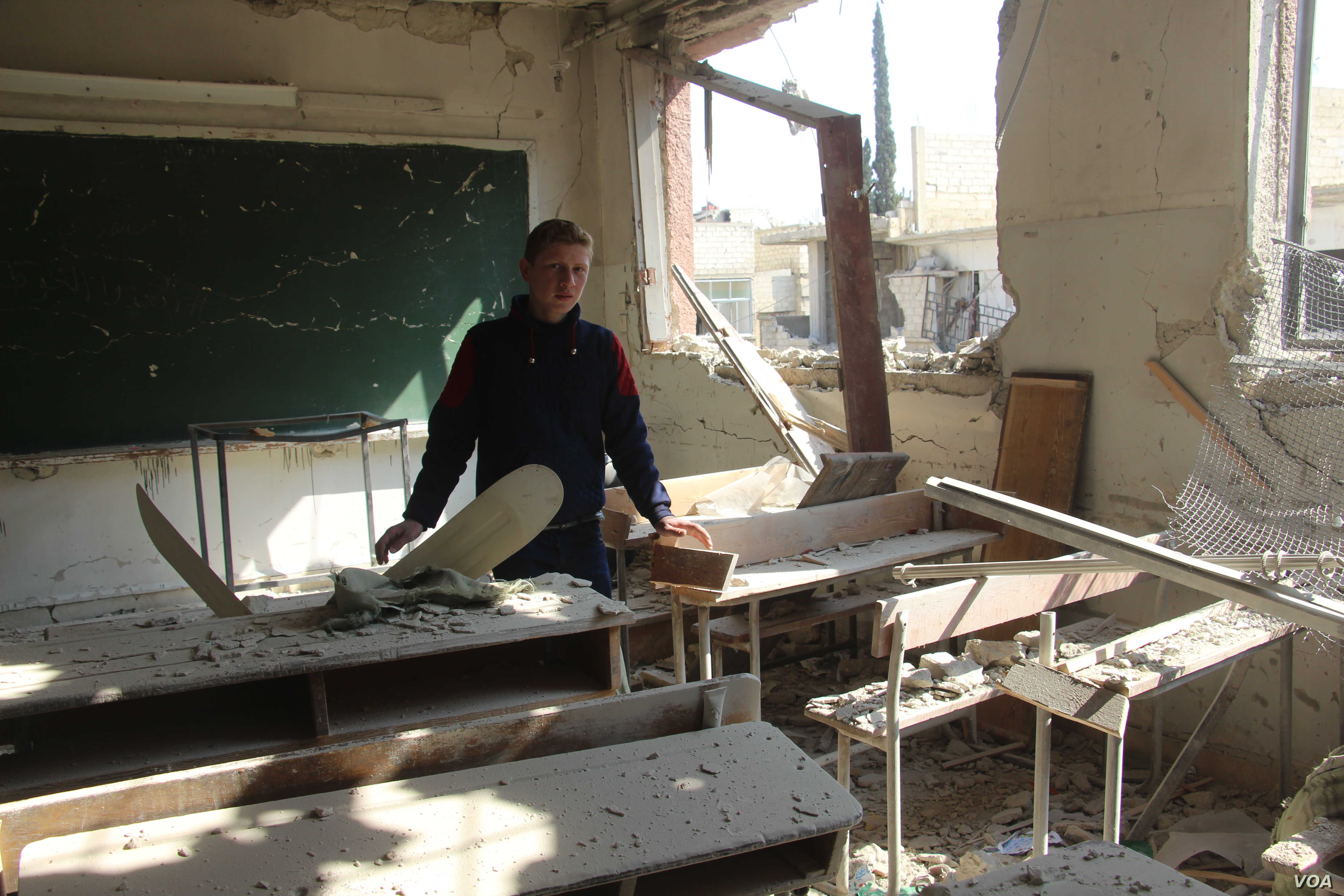 Muhammed Najem is pictured amid the rubble of his school in Eastern Ghouta, Feb. 13, 2018.