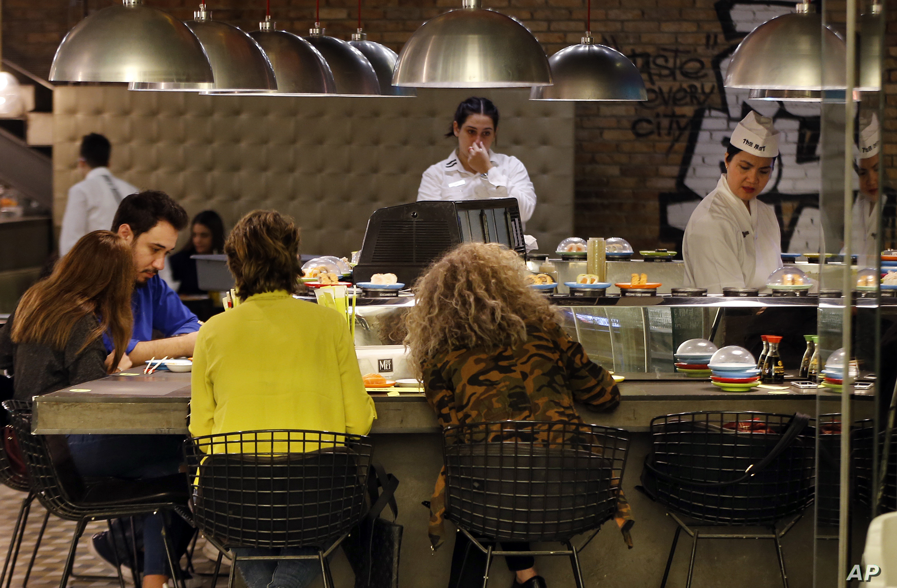 People eat sushi at a restaurant in Beirut, Lebanon, Nov. 10, 2017. Prime Minister Saad Hariri's  resignation could unravel the first steps in years toward injecting some cash and confidence in Lebanon's anemic economy.