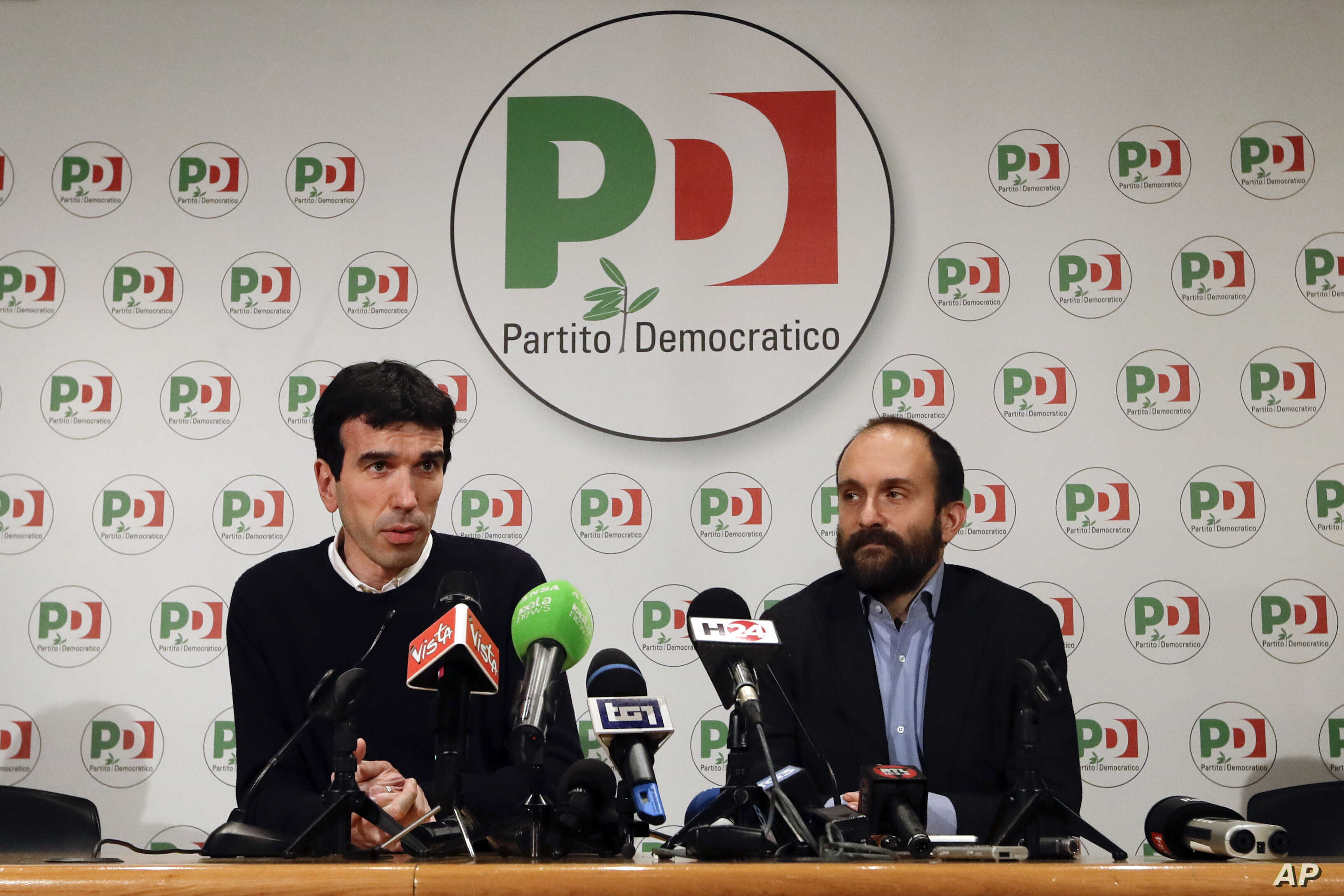 Democratic Party lawmaker Maurizio Martina, left, and President Matteo Orfini talk to journalists in the party's headquarters, in Rome, March 4, 2018.