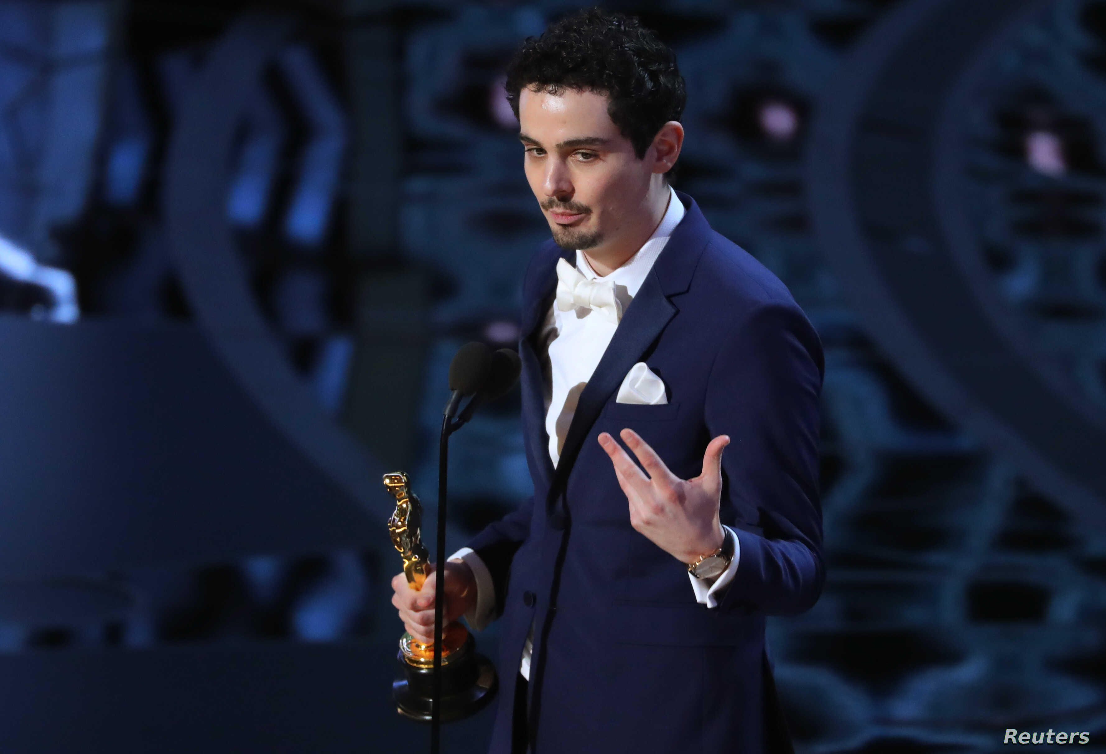 Damien Chazelle accepts the award for winning Best Director.