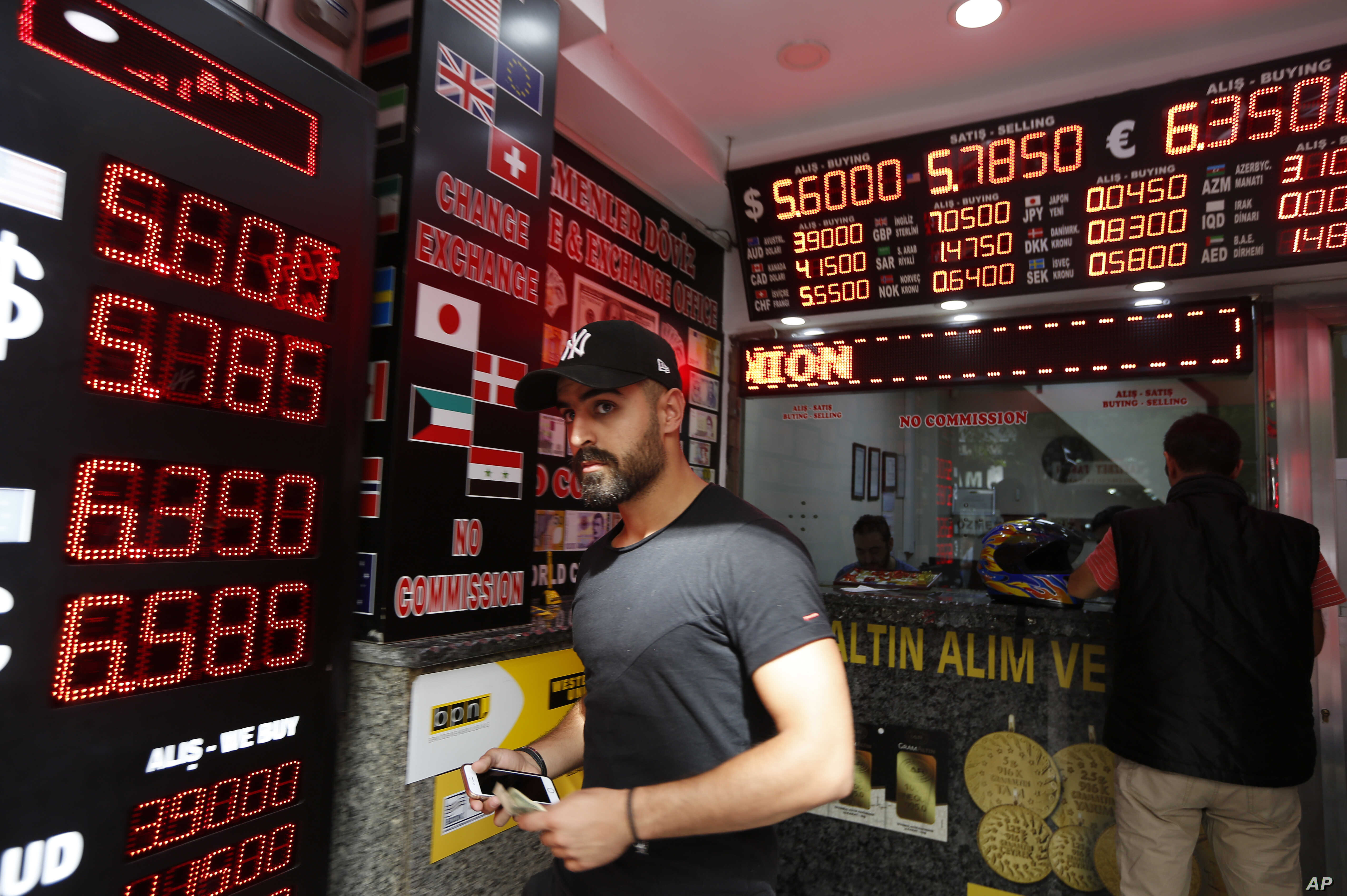 A man walks out of a currency exchange shop in Istanbul,  Aug. 16, 2018. Beset by a weak currency and tension with the United States, Turkey is reaching out to Europe in an attempt to shore up relations with major trading partners despite years of te...
