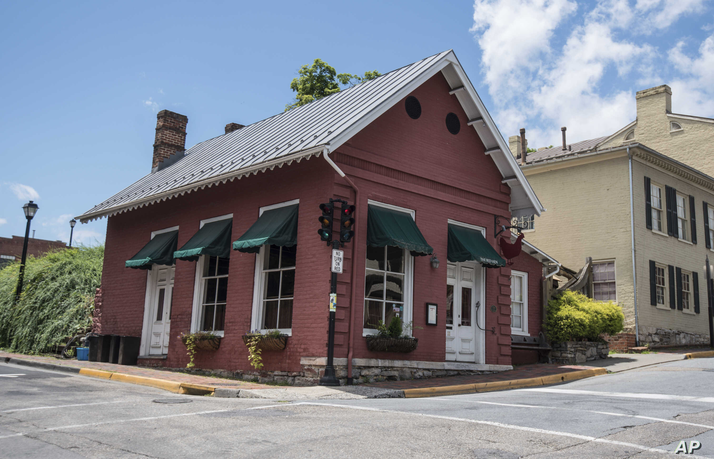 This photo shows the Red Hen Restaurant in downtown Lexington, Va., June 23, 2018.  White House press secretary Sarah Sanders said Saturday in a tweet that she was booted from the Virginia restaurant because she works for President Donald Trump.