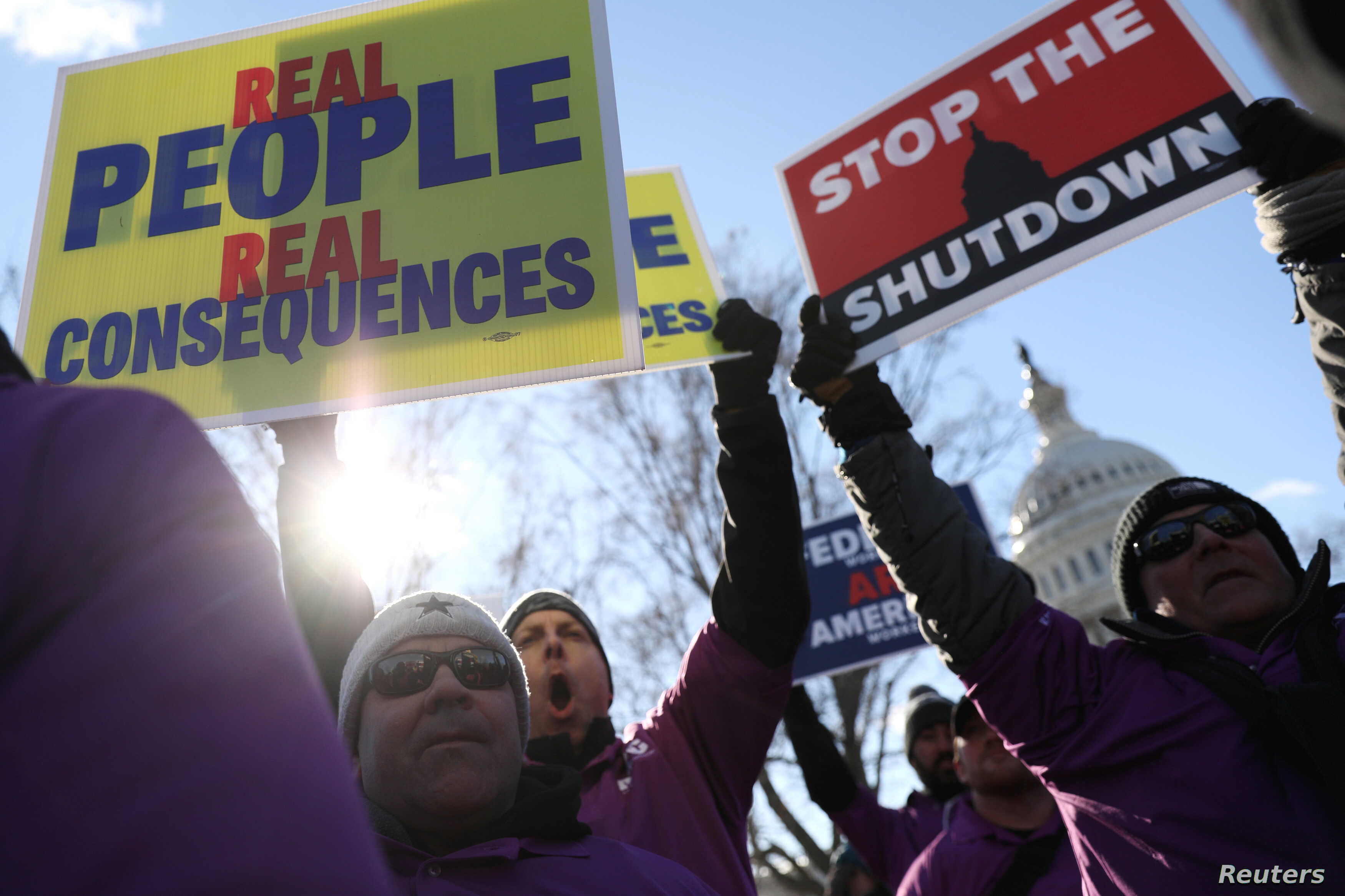 Federal air traffic controller union members protest the partial U.S. federal government shutdown in a rally at the U.S. Capitol in Washington, Jan. 10, 2019.