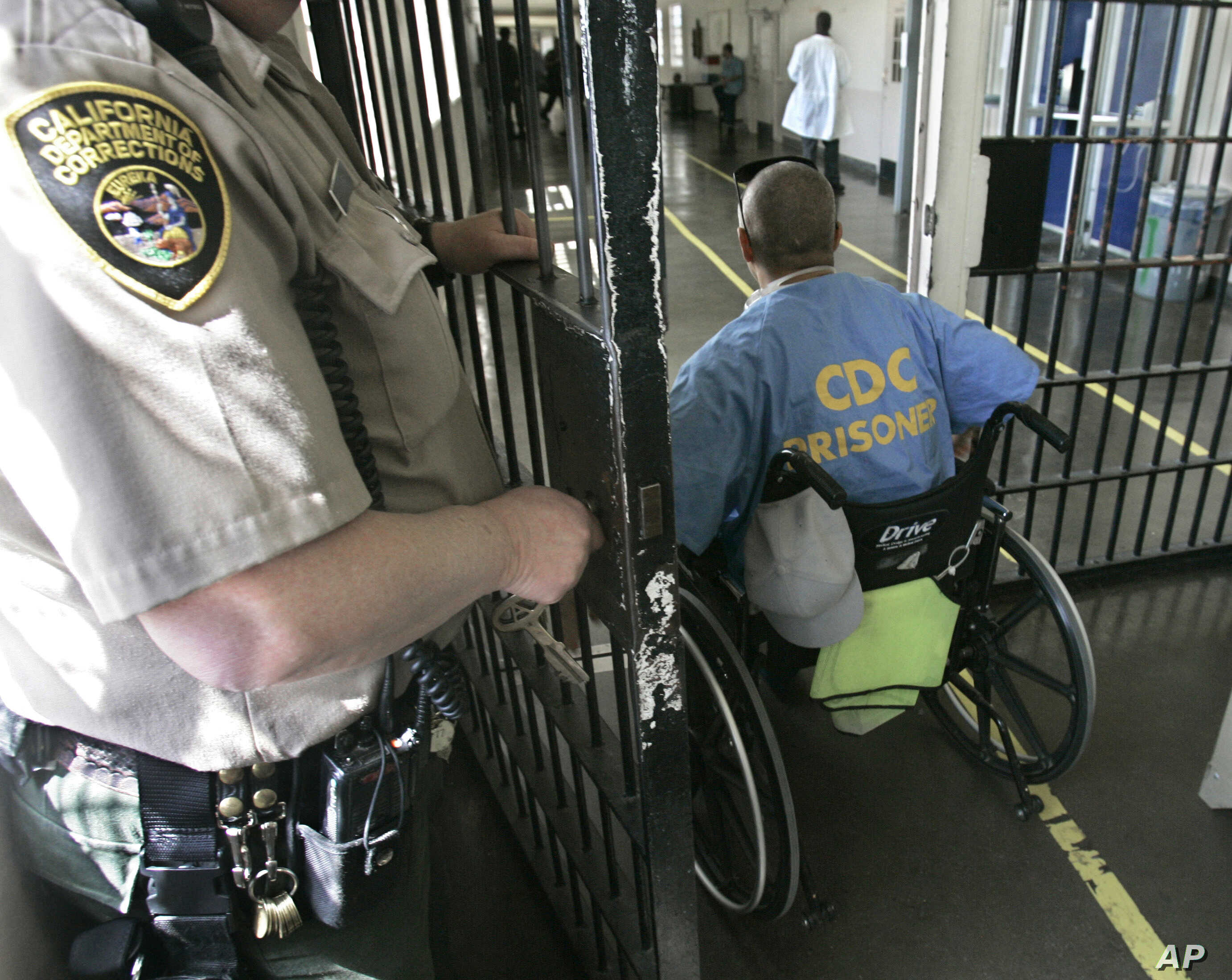In this April 9, 2008 file photo, a wheelchair bound inmate wheels himself through a check point at the California Medical Facility, in  Vacaville, Calif.