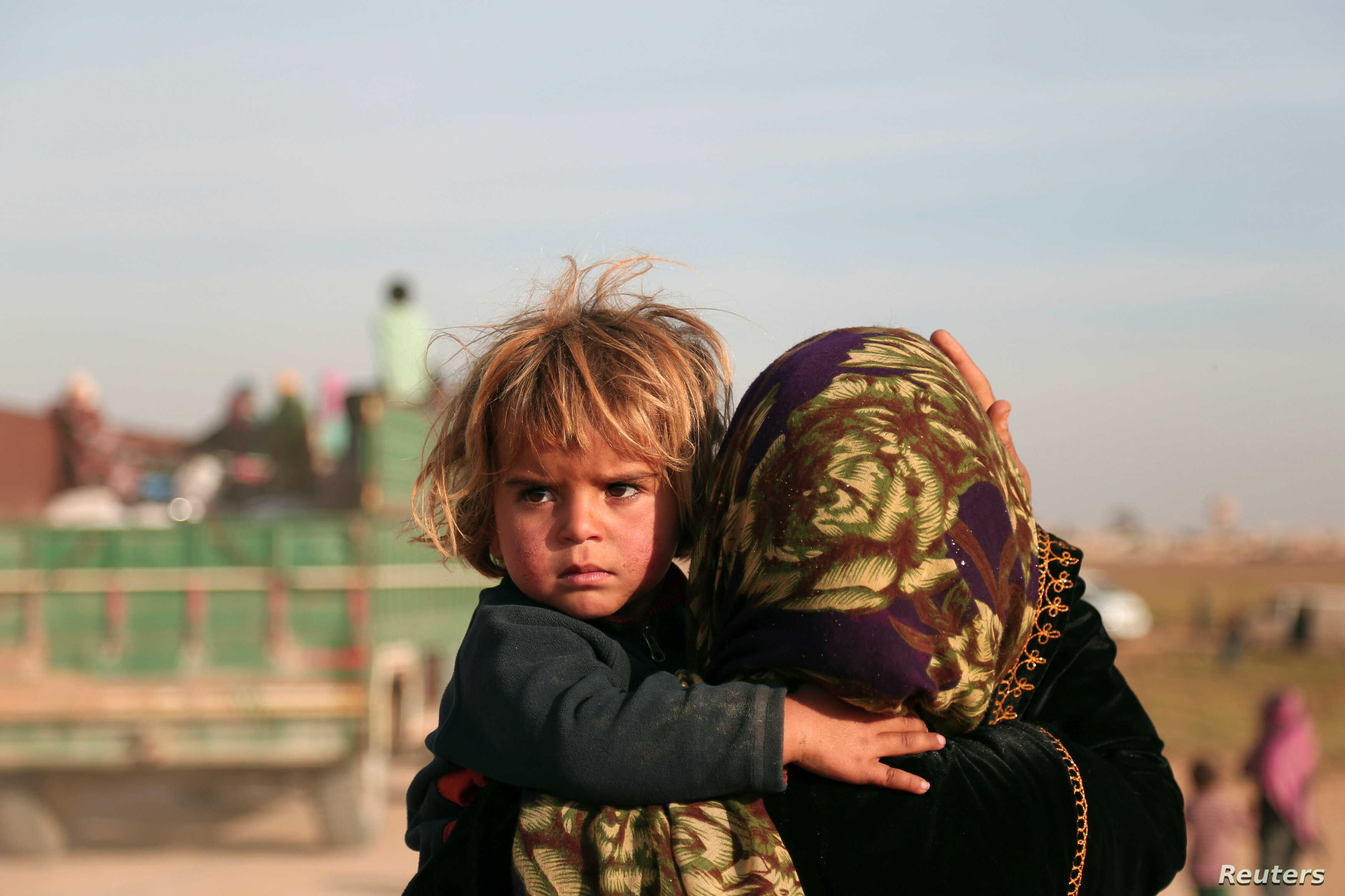 REUTERS Return of child and mother to Hisha, Syria