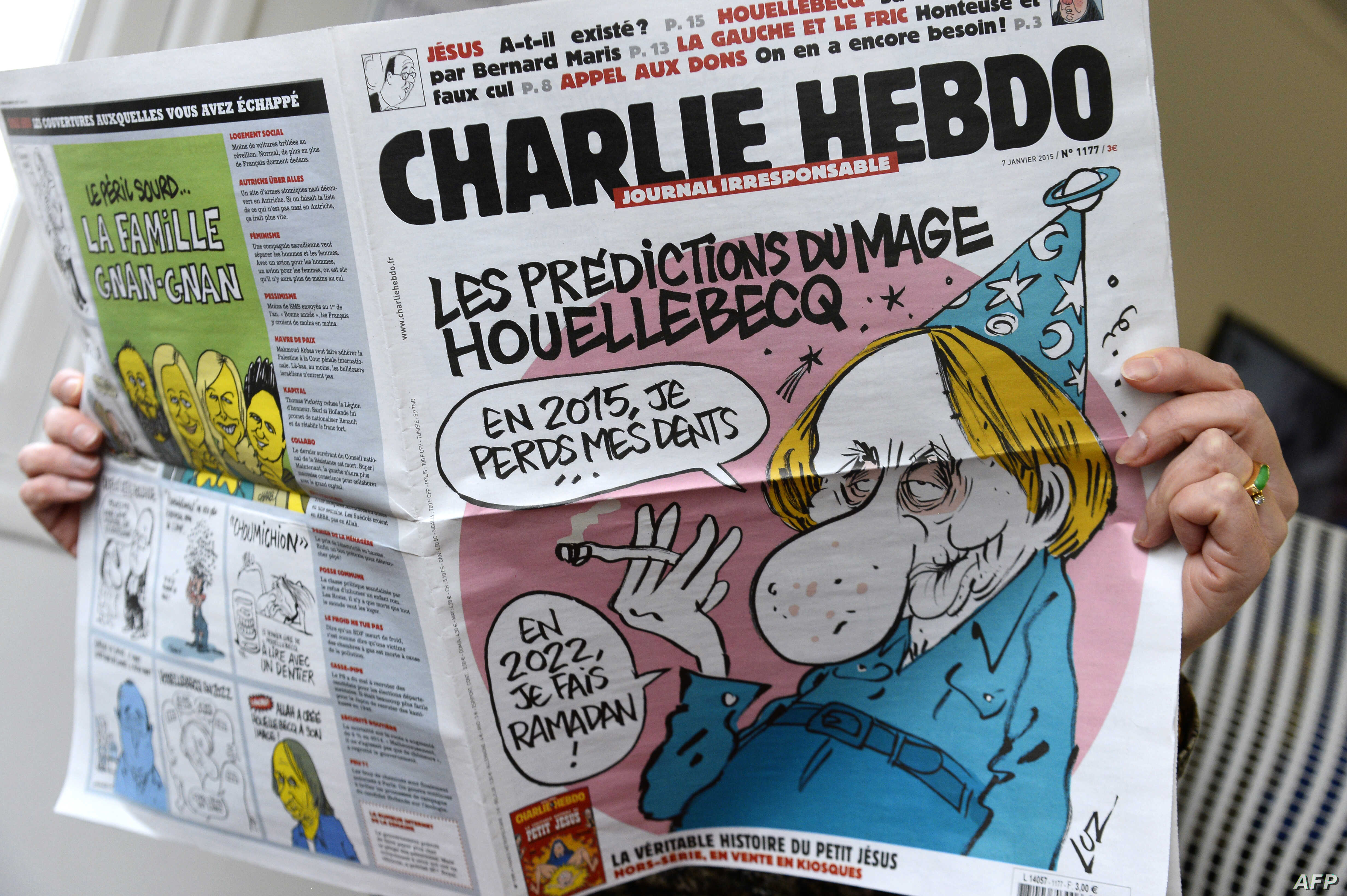 A person reads the latest issue of the French satirical newspaper Charlie Hebdo in Paris after gunmen armed with Kalashnikovs and a rocket-launcher opened fire in the offices of the weekly in Paris, killing at least 11, Jan. 7, 2015.