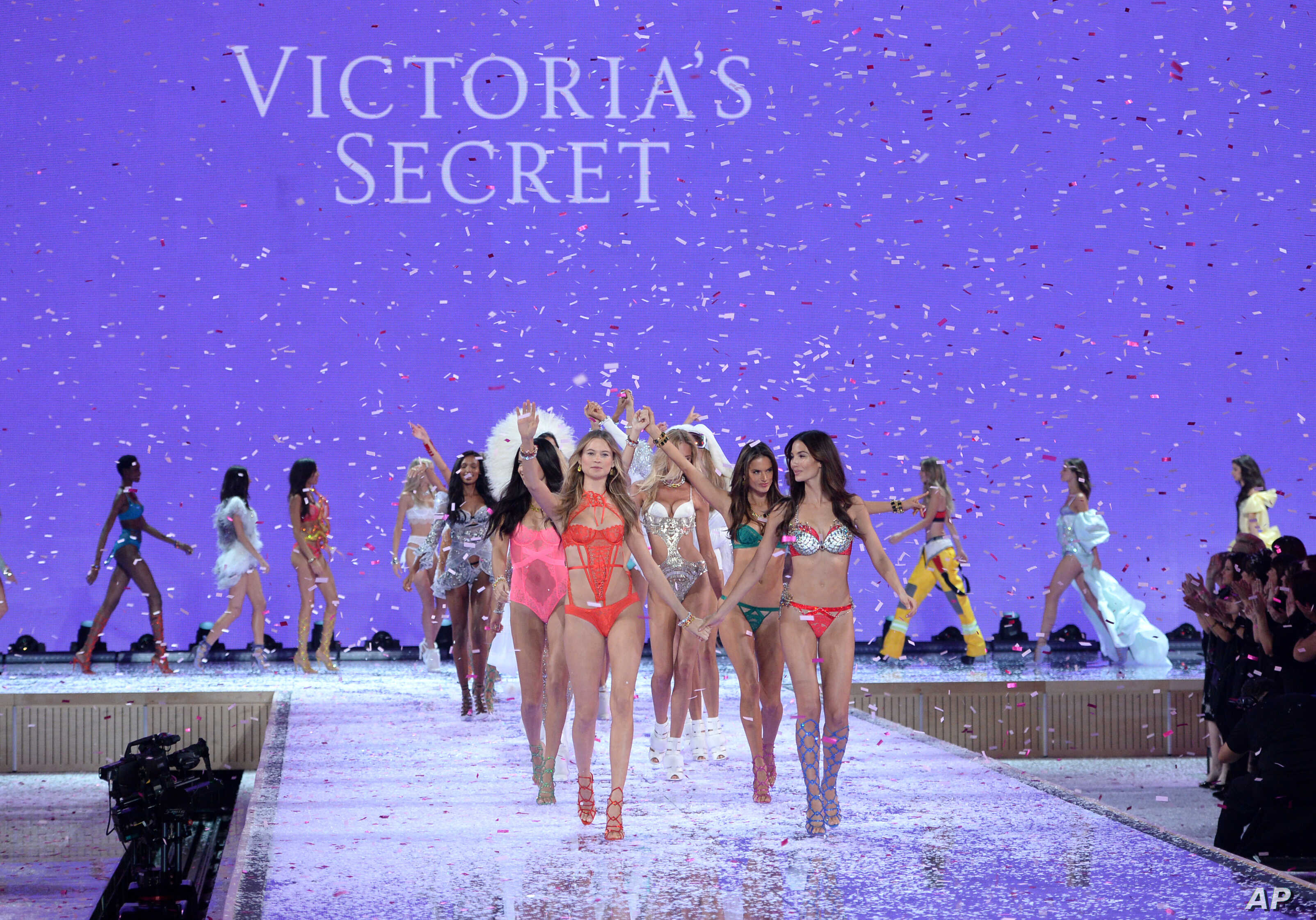 Models including Behati Prinsloo, front left, and Lily Aldridge, front right, walk the runway during the Victoria's Secret Fashion Show at the Lexington Armory on Nov. 10, 2015, in New York.