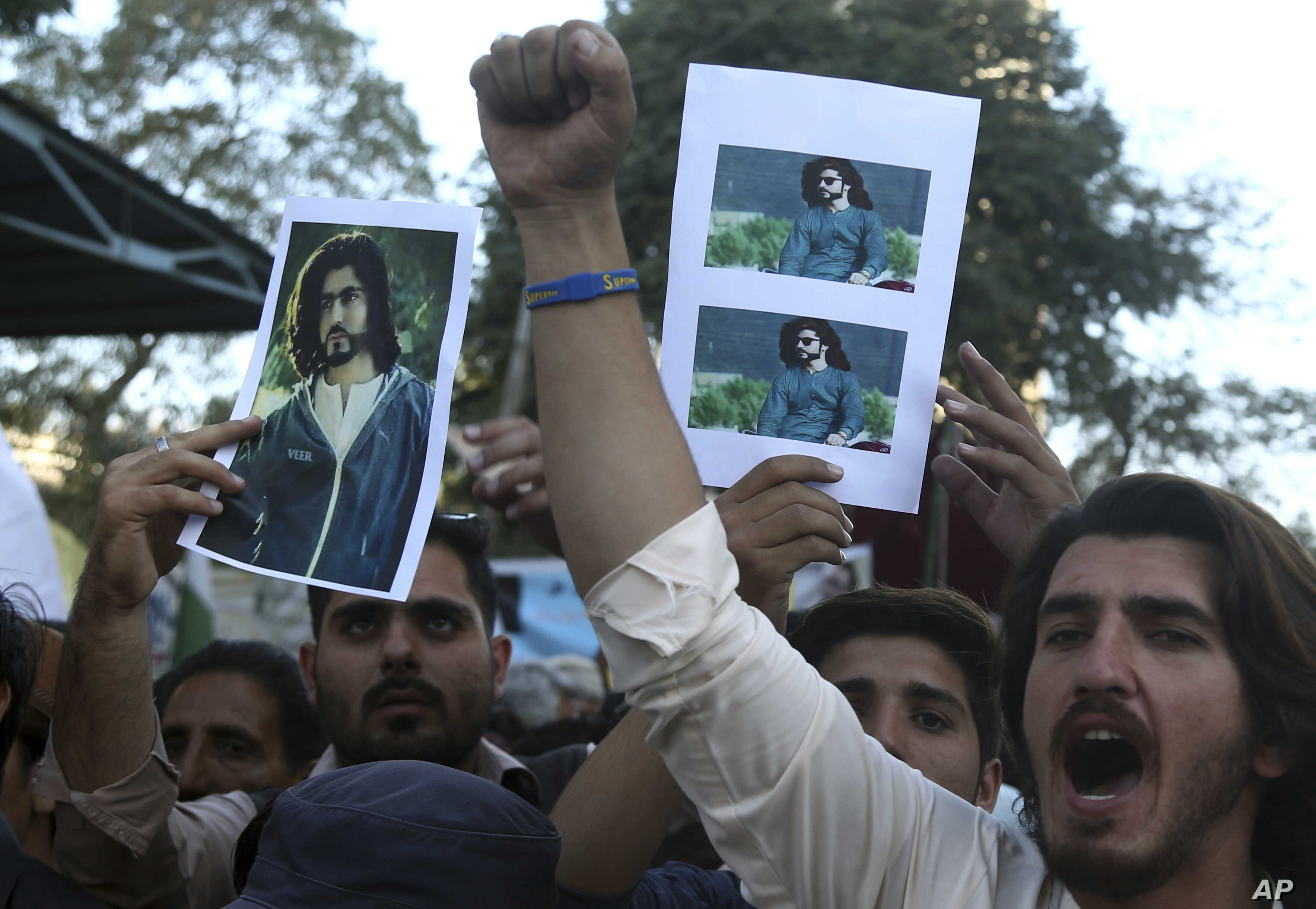 FILE - People rally to condemn the killing of Naqeebullah Mehsud, a 27-year-old aspiring model, in Karachi, Pakistan, Feb. 9, 2018.