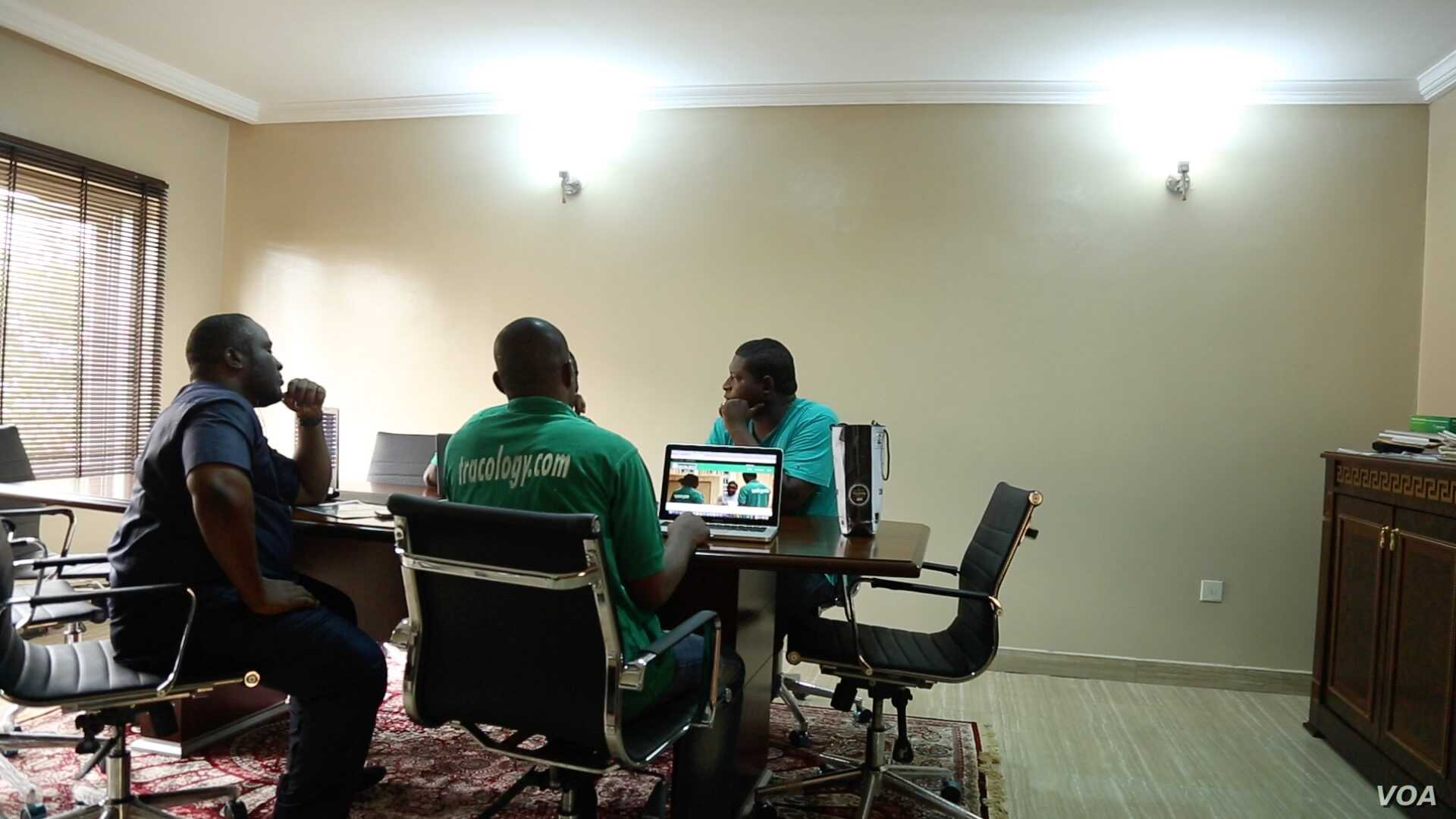 Emma Okena, CEO of Tracology, and his team meet to discuss how to move their startup company forward in Abuja, Nigeria, Sept. 5, 2016. Tracology is a payment management system that uses a barcode to allow users and the government to track utility bil...